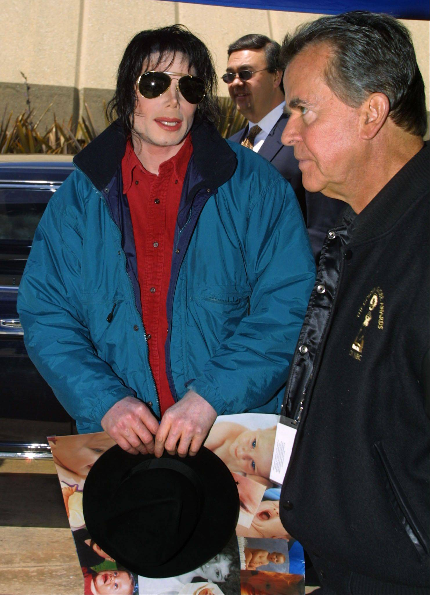 Performer Michael Jackson, left, talks with Dick Clark, host of the American Bandstand 50th...A Celebration as Jackson arrives for the taping of the show Saturday, April 20, 2002 in Pasadena, Calif.
