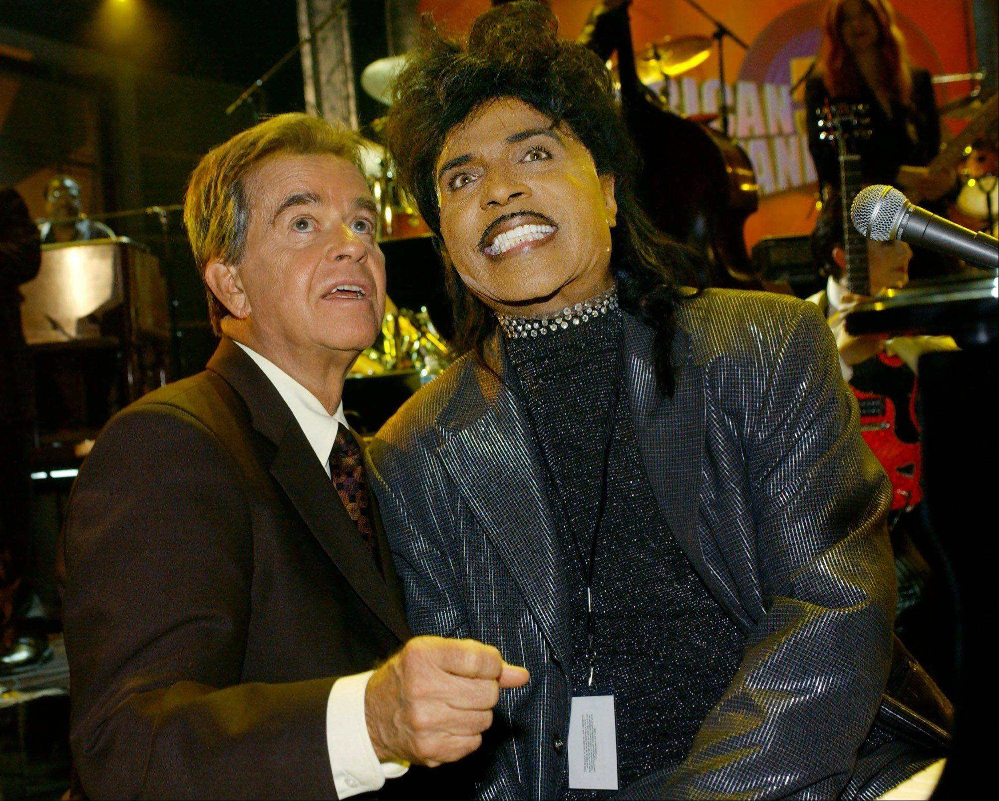 """American Bandstand"" host Dick Clark, left, has a word with Little Richard before the ""supergroup"" finale of ""American Bandstand's 50th...A Celebration,"" Sunday, April 21, 2002, at the Pasadena Civic Auditorium in Pasadena, Calif."