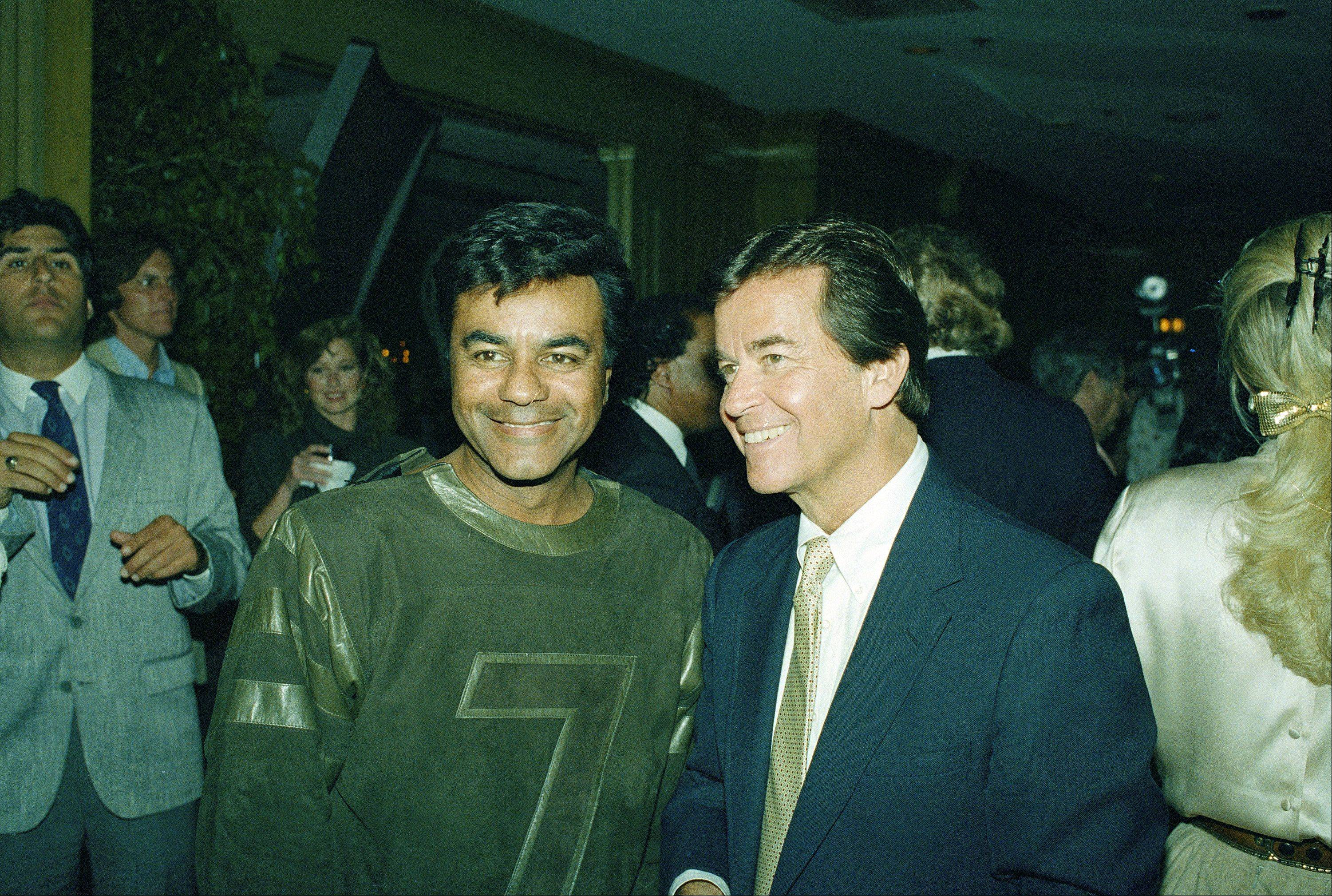"Johnny Mathis and Dick Clark are photographed at a party in Chasen's Restaurant in the Los Angeles to honor Clark's program "" American Bandstand."" September 11, 1987."