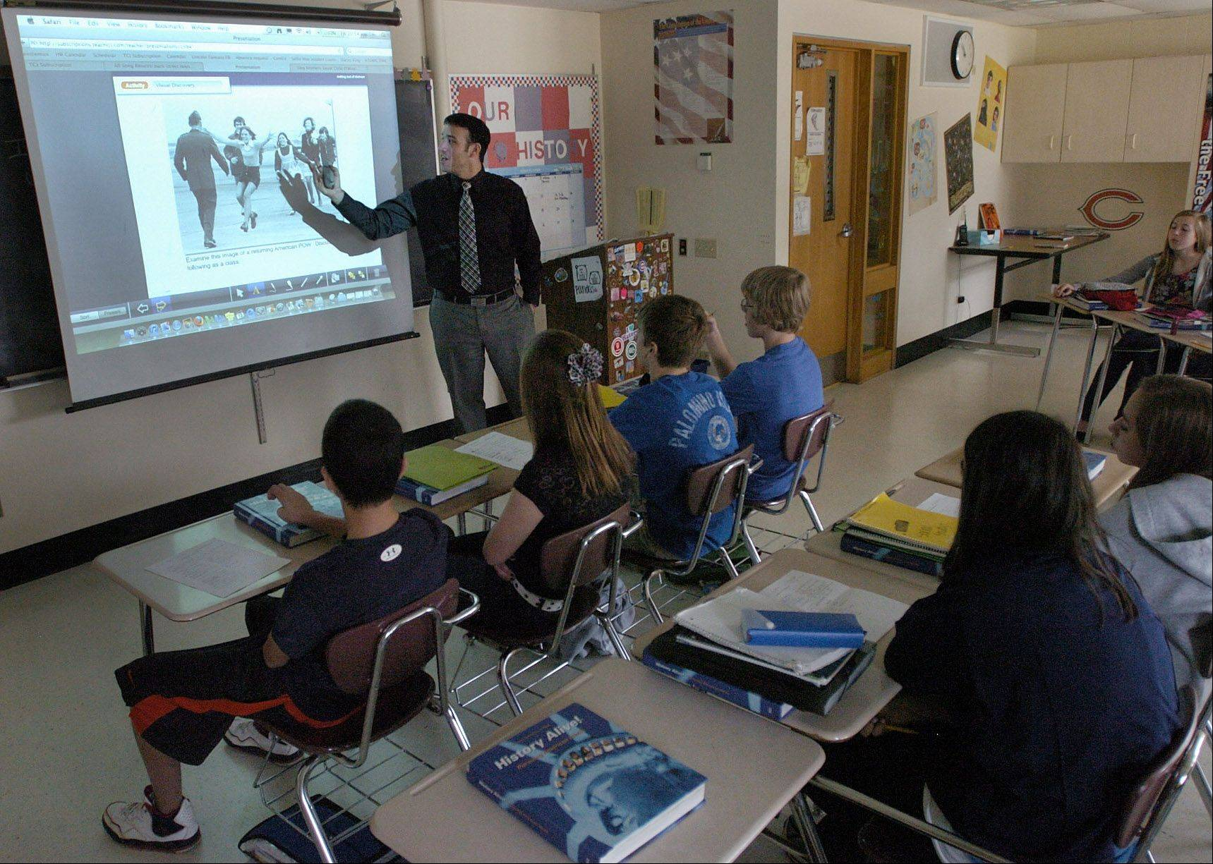 Dominick Lupo and his eighth grade class at Lincoln Middle School study the Vietnam War through the school's History Alive social studies curriculum program. Mount Prospect Elementary School District 57 plans to upgrade the interactive curriculum next year in hopes of getting students more interested in studying history.