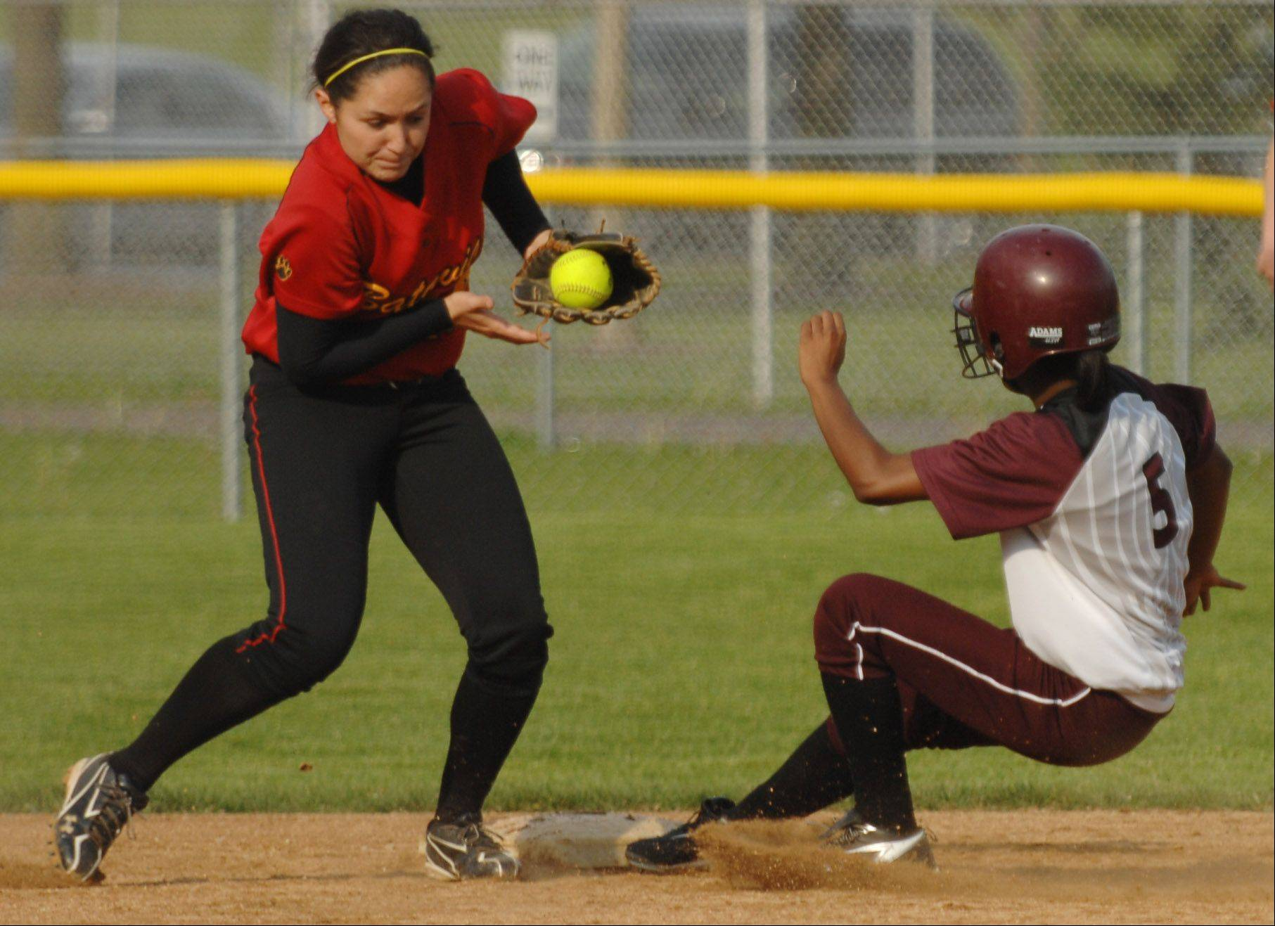 Elgin's Kenyatta Scales reaches second base ahead of the throw caught by Batavia shortstop Sami Villarreal for a stolen base Wednesday in Elgin.