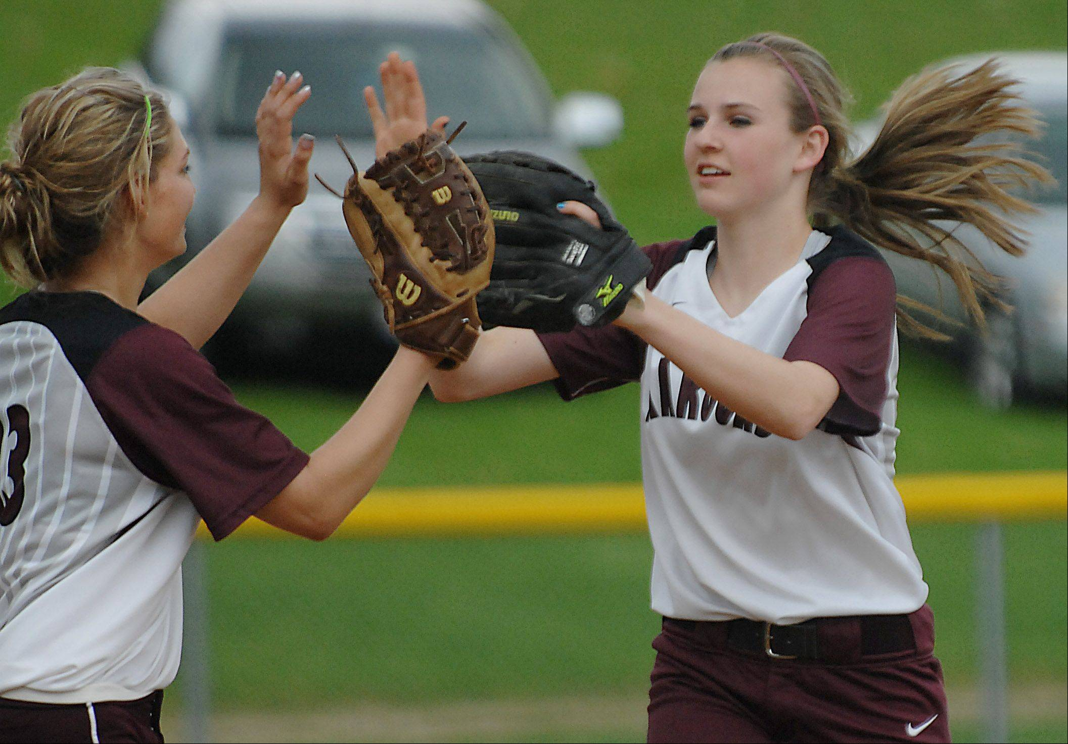 Elgin Bri Wright is met by pitcher Hannah Perryman after recording the third out of the sixth inning on a good defensive play to rob Batavia's Katie Ryan of a hit Wednesday in Elgin. Elgin won 1-0.