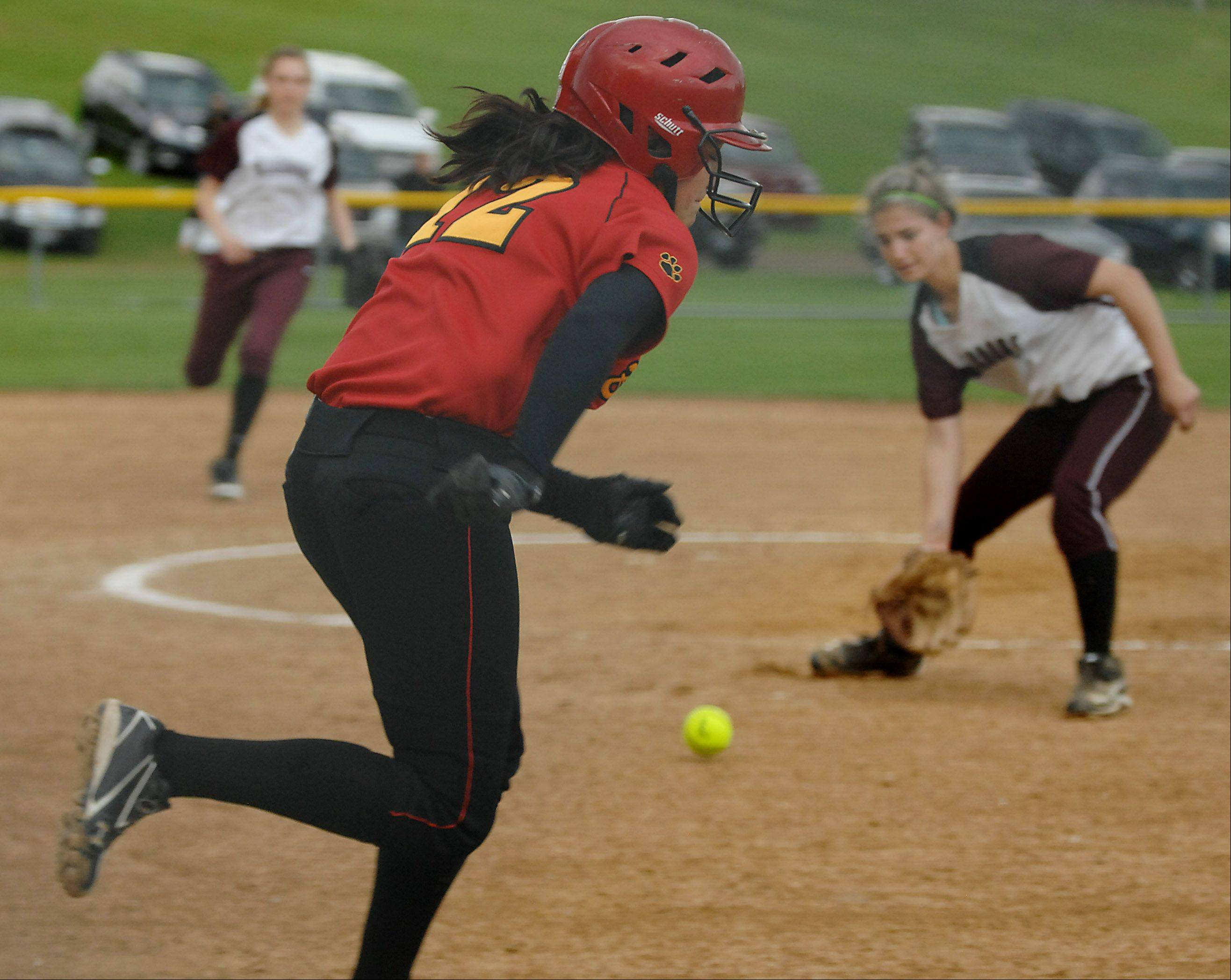 Batavia's Sami Villarreal tries to beat the play by Elgin pitcher Hannah Perryman who fields her bunt in the sixth inning Wednesday in Elgin. She was thrown out.