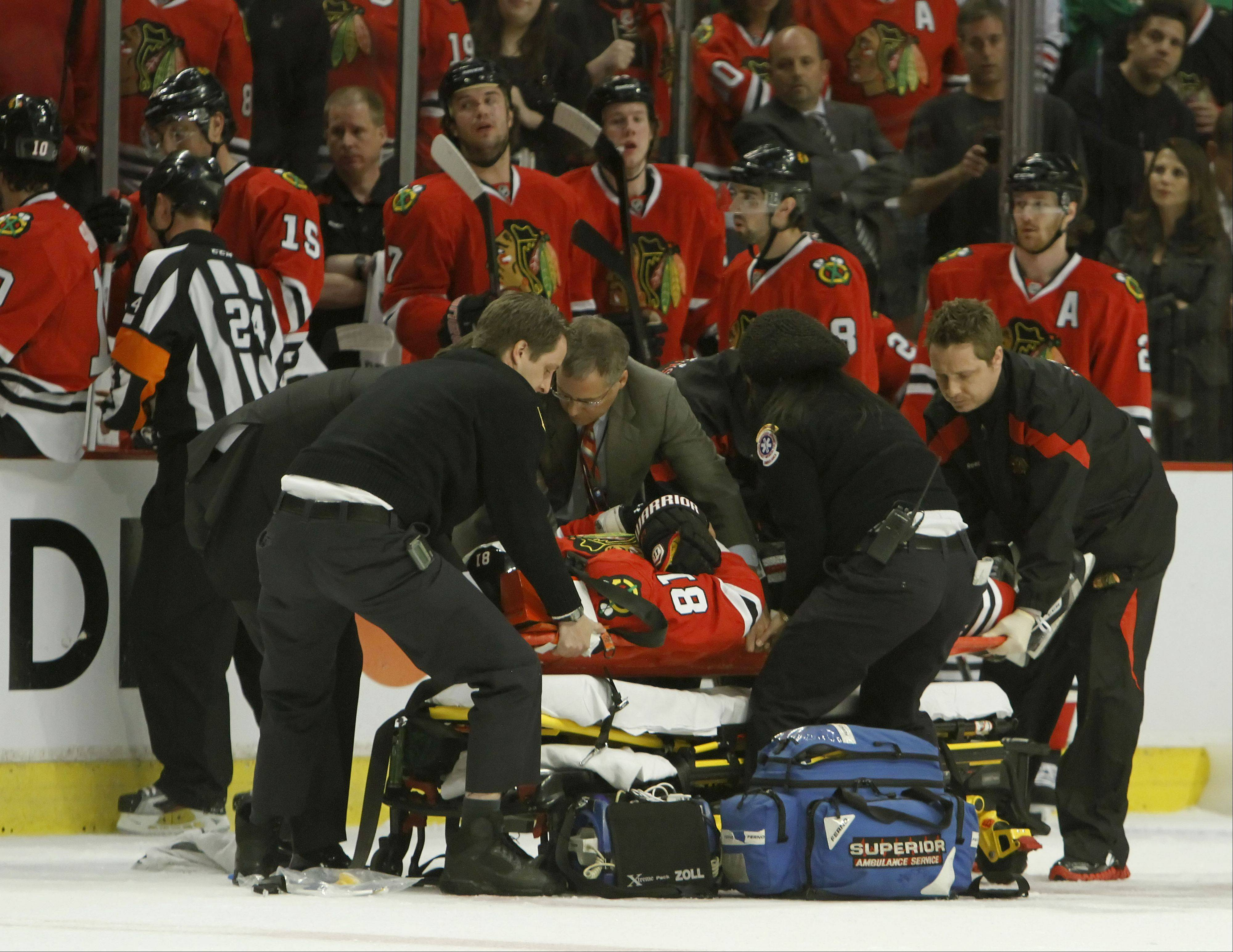 Chicago Blackhawks right wing Marian Hossa is taken off the ice on a stretcher after getting an elbow from Phoenix Coyotes left wing Raffi Torres during Game 3 of the Western Conference quarterfinals Tuesday at the United Center. Torres was suspended indefinitely by the NHL pending a hearing Friday.