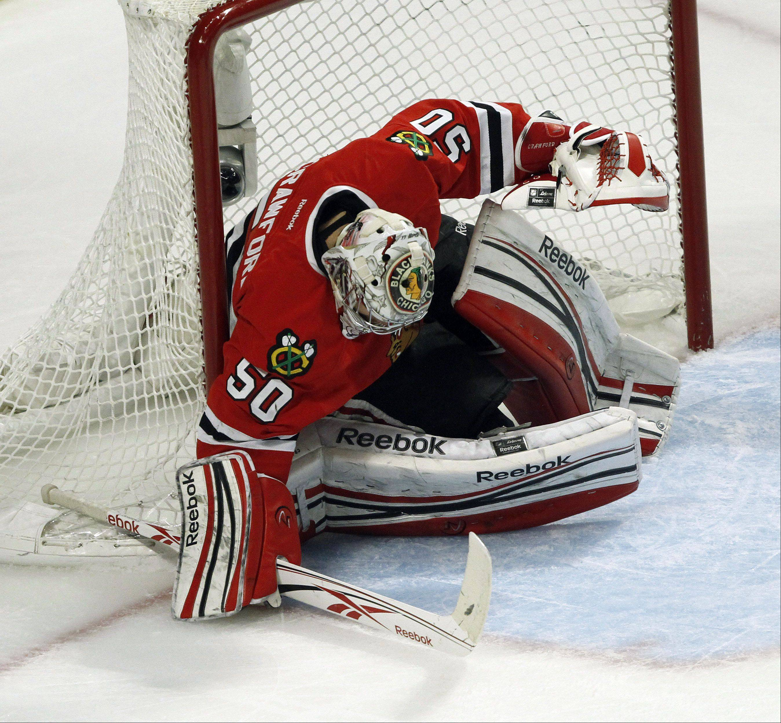 Chicago Blackhawks goalie Corey Crawford looks back as the winning goal goes into the net in overtime during Game 3 of the Western Conference quarterfinals at The United Center in Chicago Tuesday night. Hawks lost 3-2.