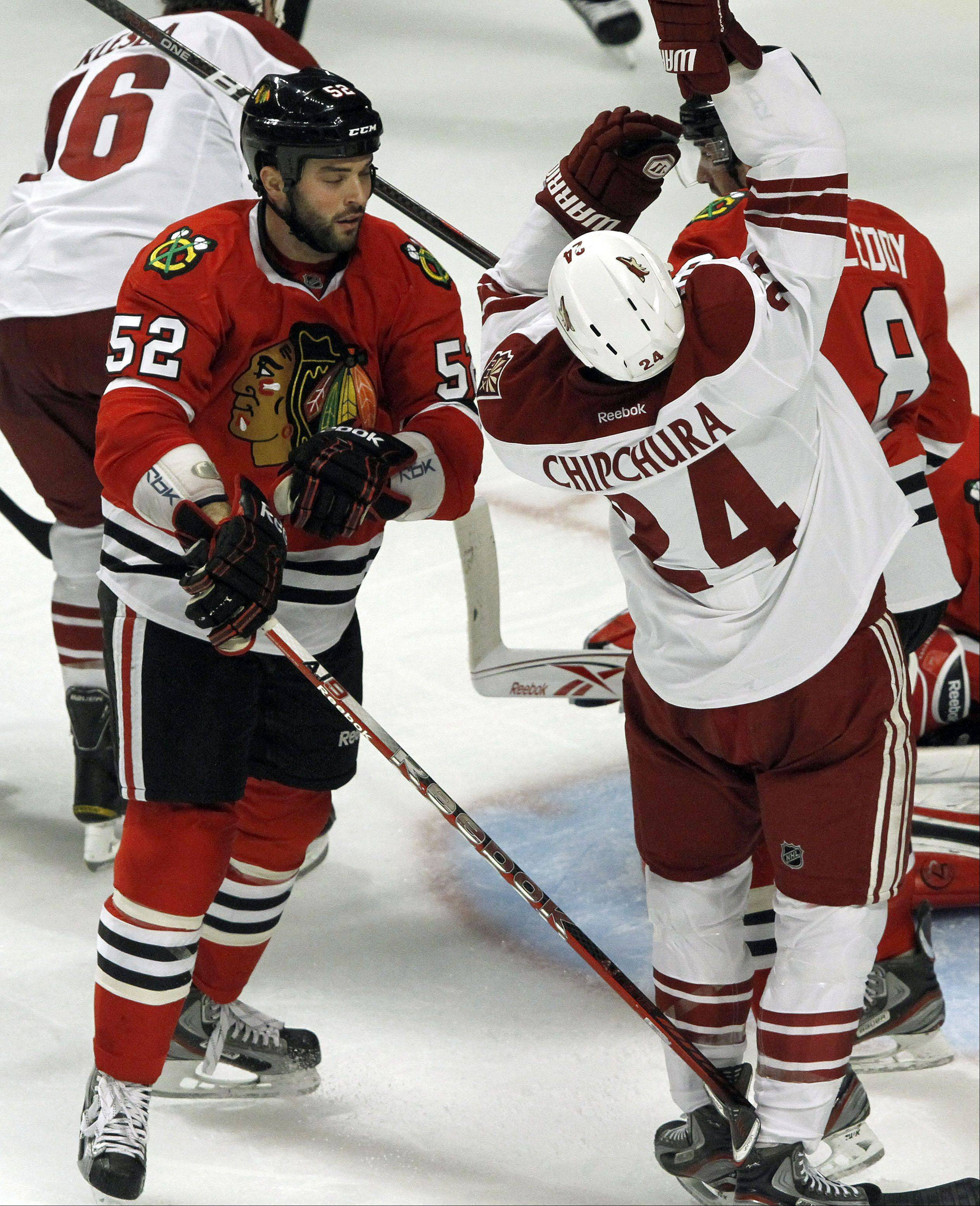 Chicago Blackhawks' left wing Brandon Bollig gets into an altercation with Phoenix Coyotes center Kyle Chipchura during Game 3 of the Western Conference quarterfinals at The United Center in Chicago Tuesday night.