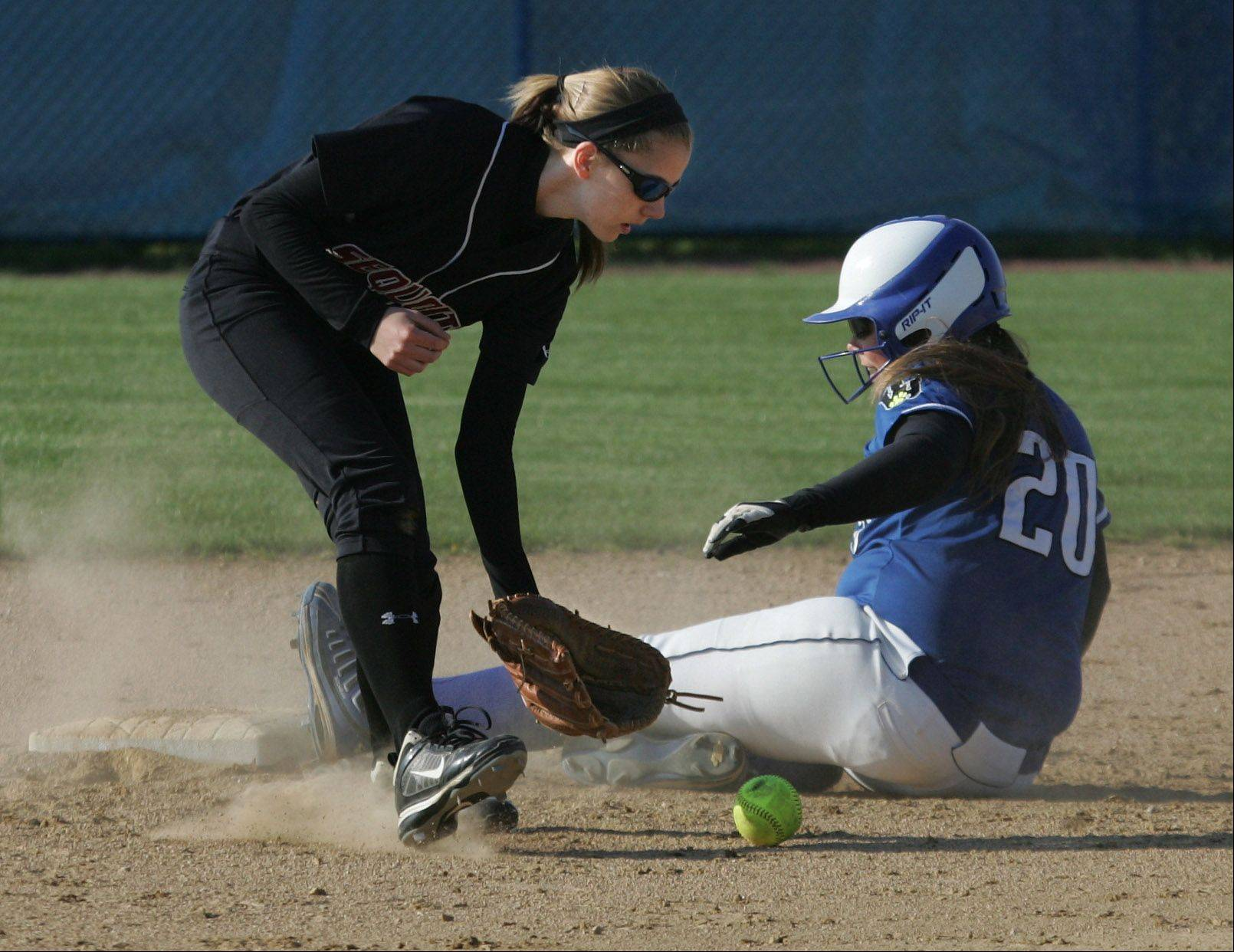 Vernon Hills baserunner Anya Mollenhauer slides safely into second base as Antioch shortstop Jessica Pedersen catches the ball in the second inning Tuesday at Vernon Hills.