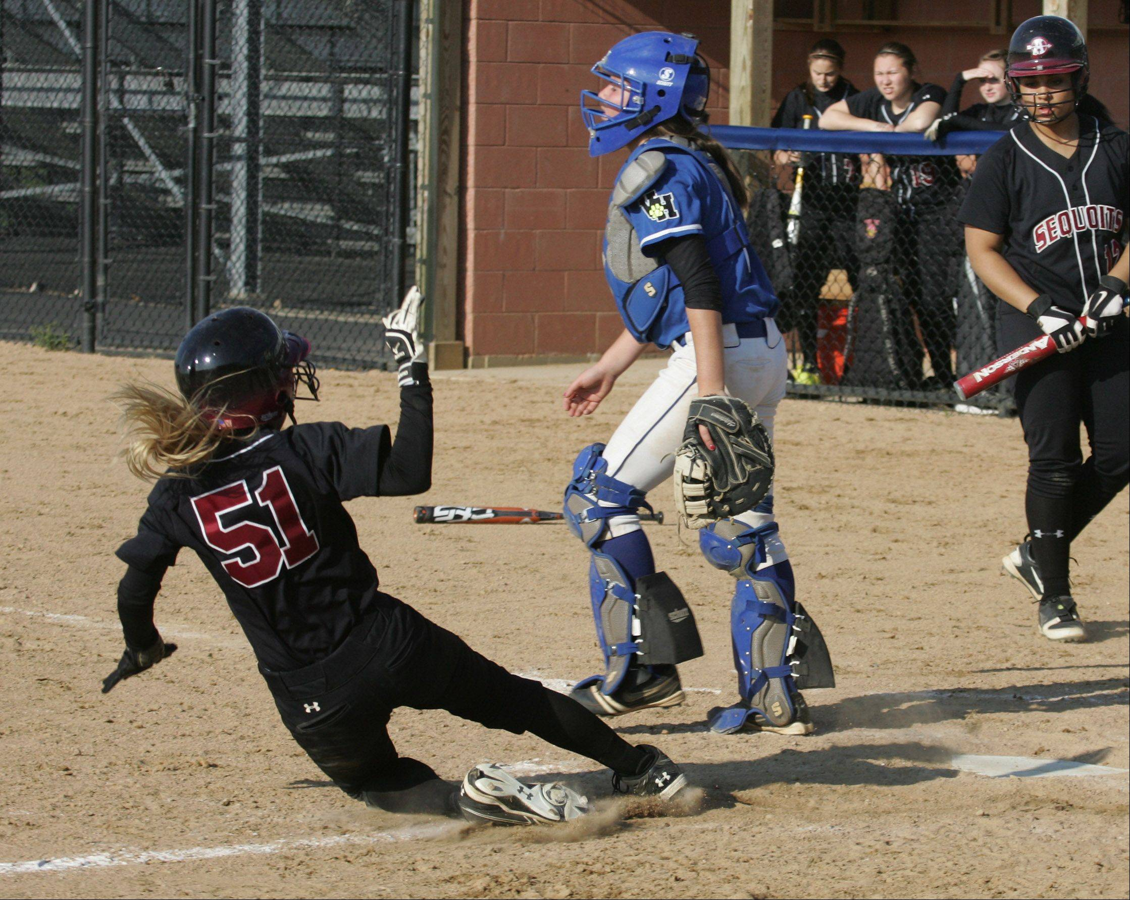 Antioch's Hannah Skoog slides into home in the third, inning scoring her second run of the game Tuesday as Vernon Hills catcher Sami Freibrun awaits the throw.