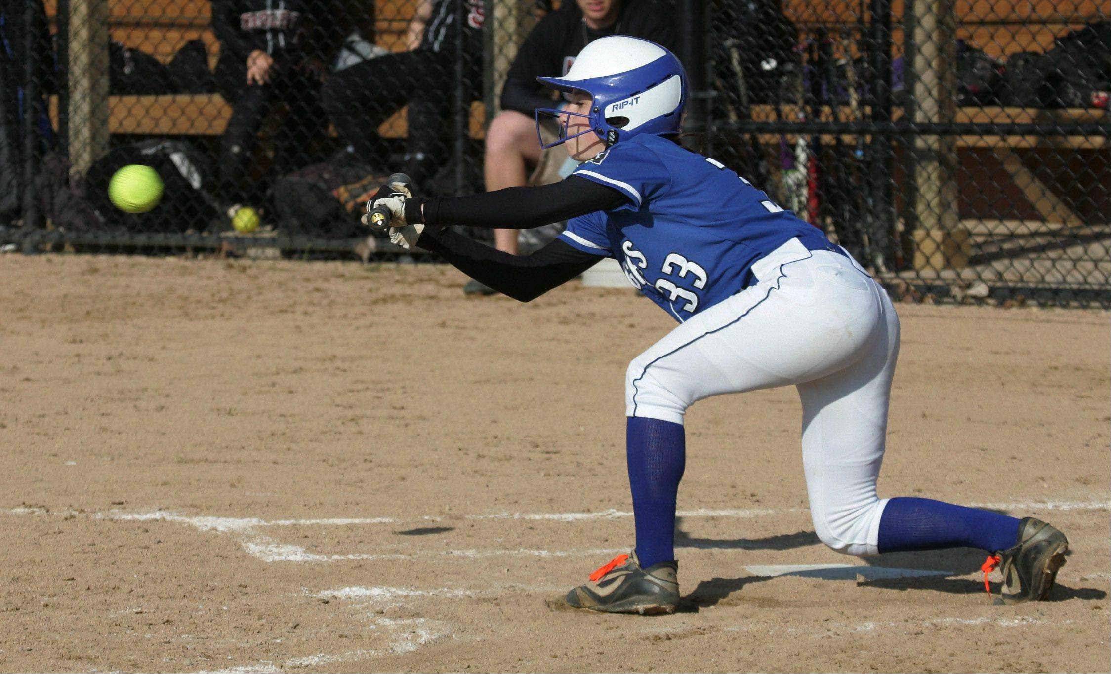 Vernon Hills batter Carly Alm bunts in the first inning Tuesday.