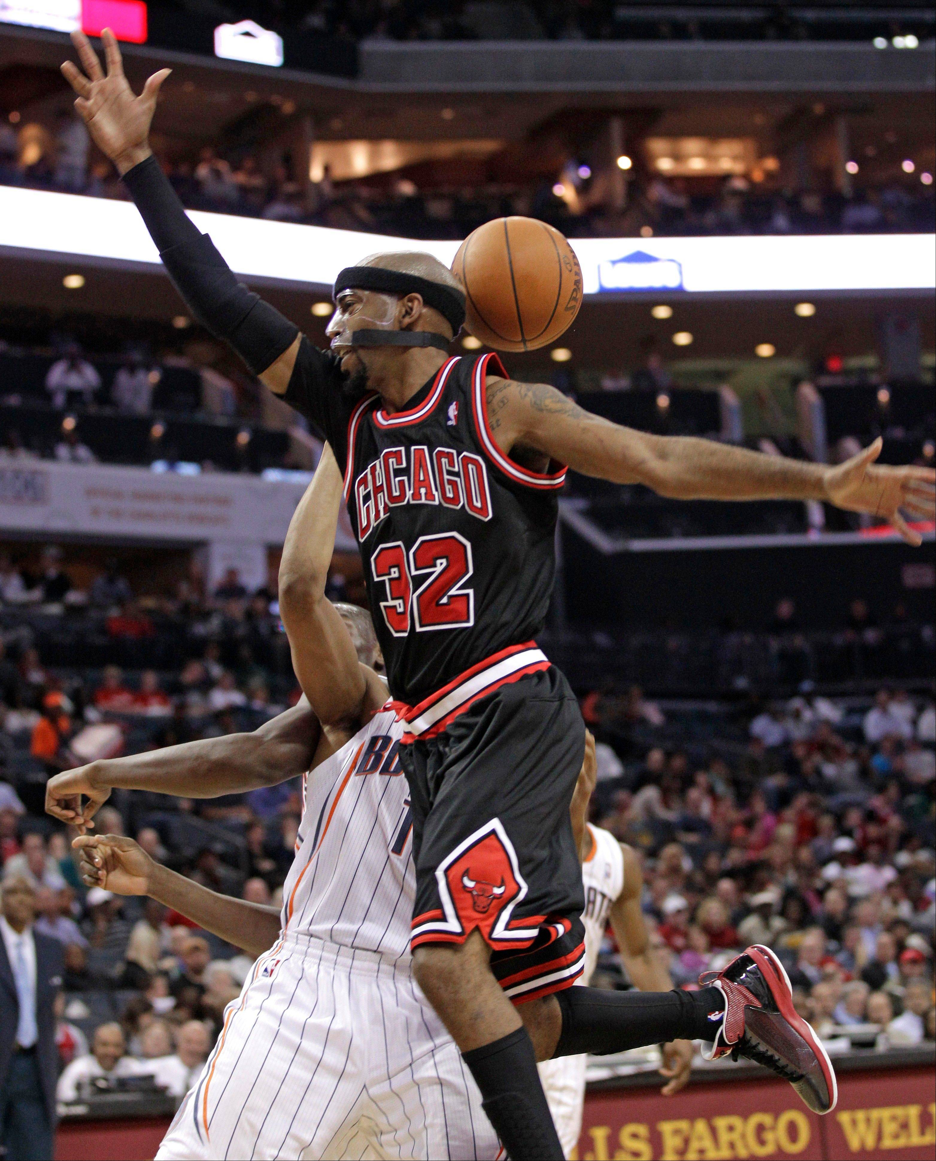 The Bulls' Richard Hamilton, fouled here by Charlotte's Gerald Henderson, finished with 24 points in 24 minutes.