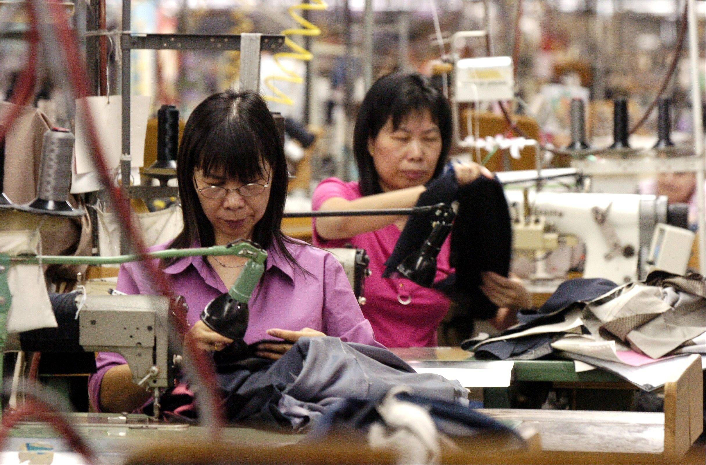 Li Yu Lan Chen has worked at suitmaker Hart Schaffner & Marx in Des Plaines for 10 years. The company, which emerged from bankruptcy in 2009, is seeking a $1.5 million federal grant to expand its operations and workforce in Des Plaines.