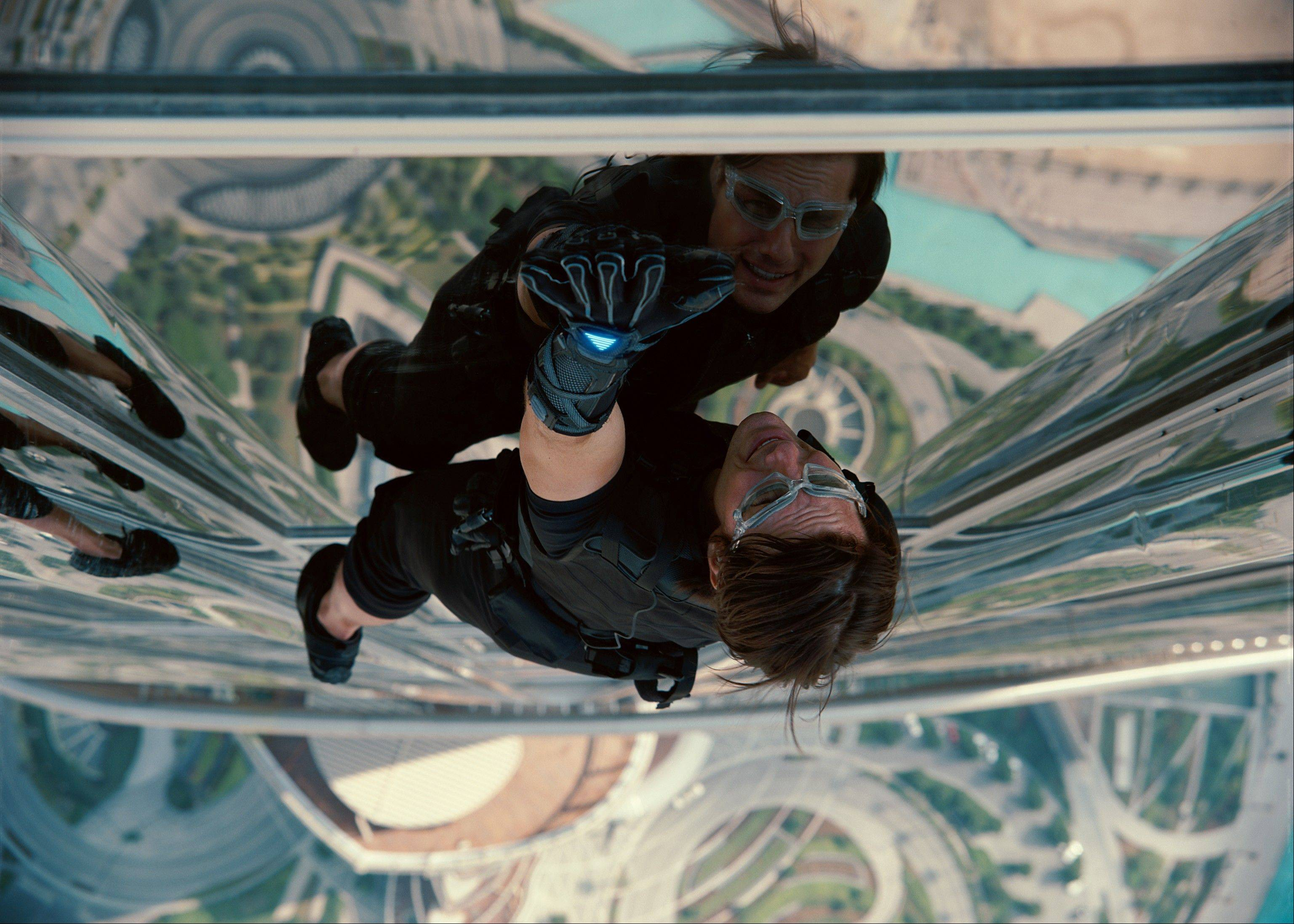 "IMF agent Ethan Hunt (Tom Cruise) scales a building in ""Mission: Impossible -- Ghost Protocol."" now on DVD."