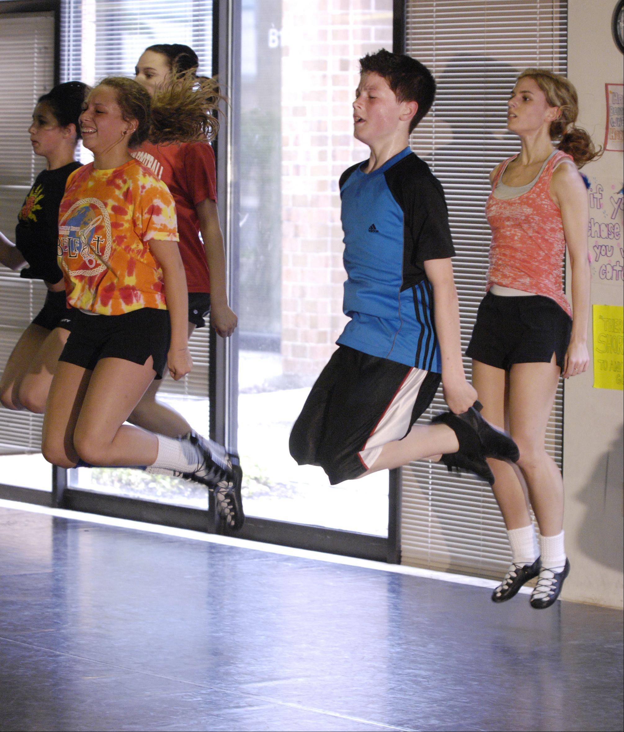 Peter Dziak, 14, of Villa Park practices with fellow members of the Trinity Irish Dancers in Elmhurst. Dziak successfully defended his world title to secure his second gold medal at the World Irish Dancing Championships in Belfast, Ireland.