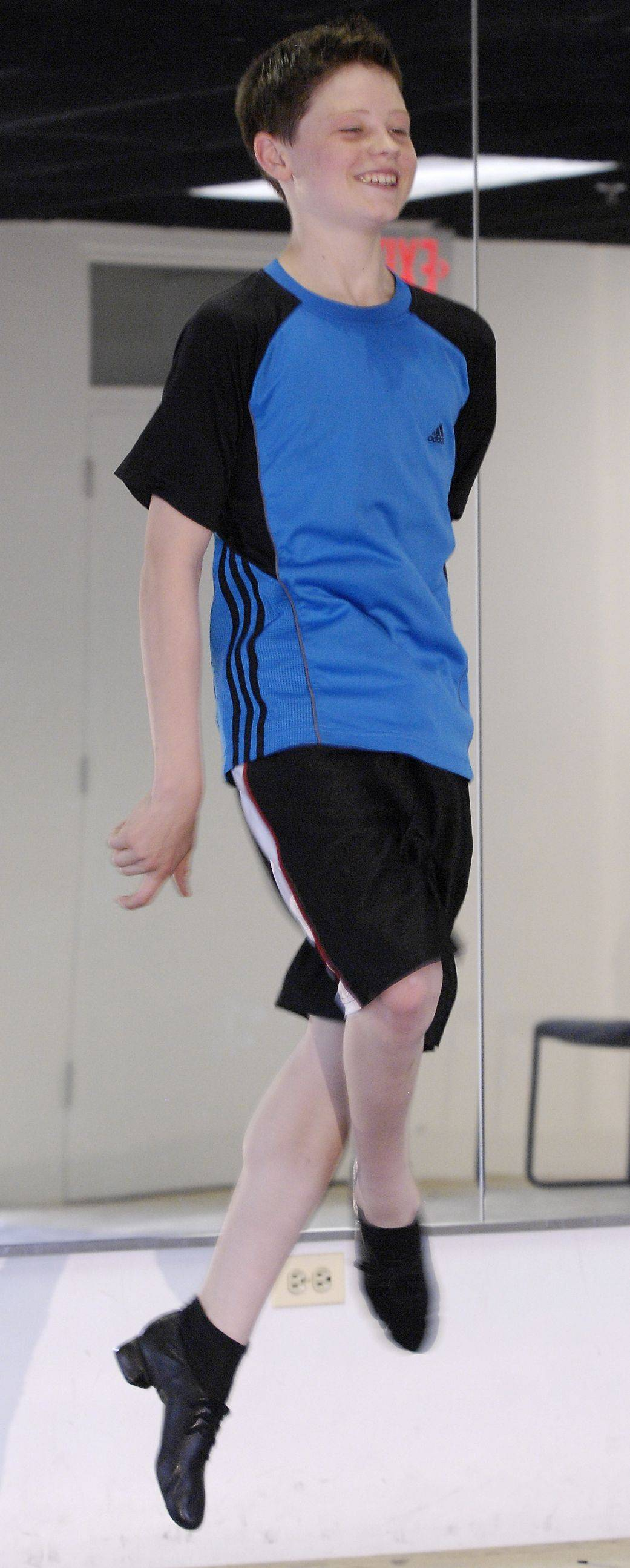 Peter Dziak, 14, of Villa Park practices at Trinity Irish Dancers in Elmhurst. Dziak successfully defended his world title to secure his second gold medal at the World Irish Dancing Championships in Belfast, Ireland.$PHOTOCREDIT_ON$$PHOTOCREDIT_OFF$$PHOTOCREDIT_ON$$PHOTOCREDIT_OFF$$PHOTOCREDIT_ON$Mark Black/mblack@ dailyherald.com$PHOTOCREDIT_OFF$