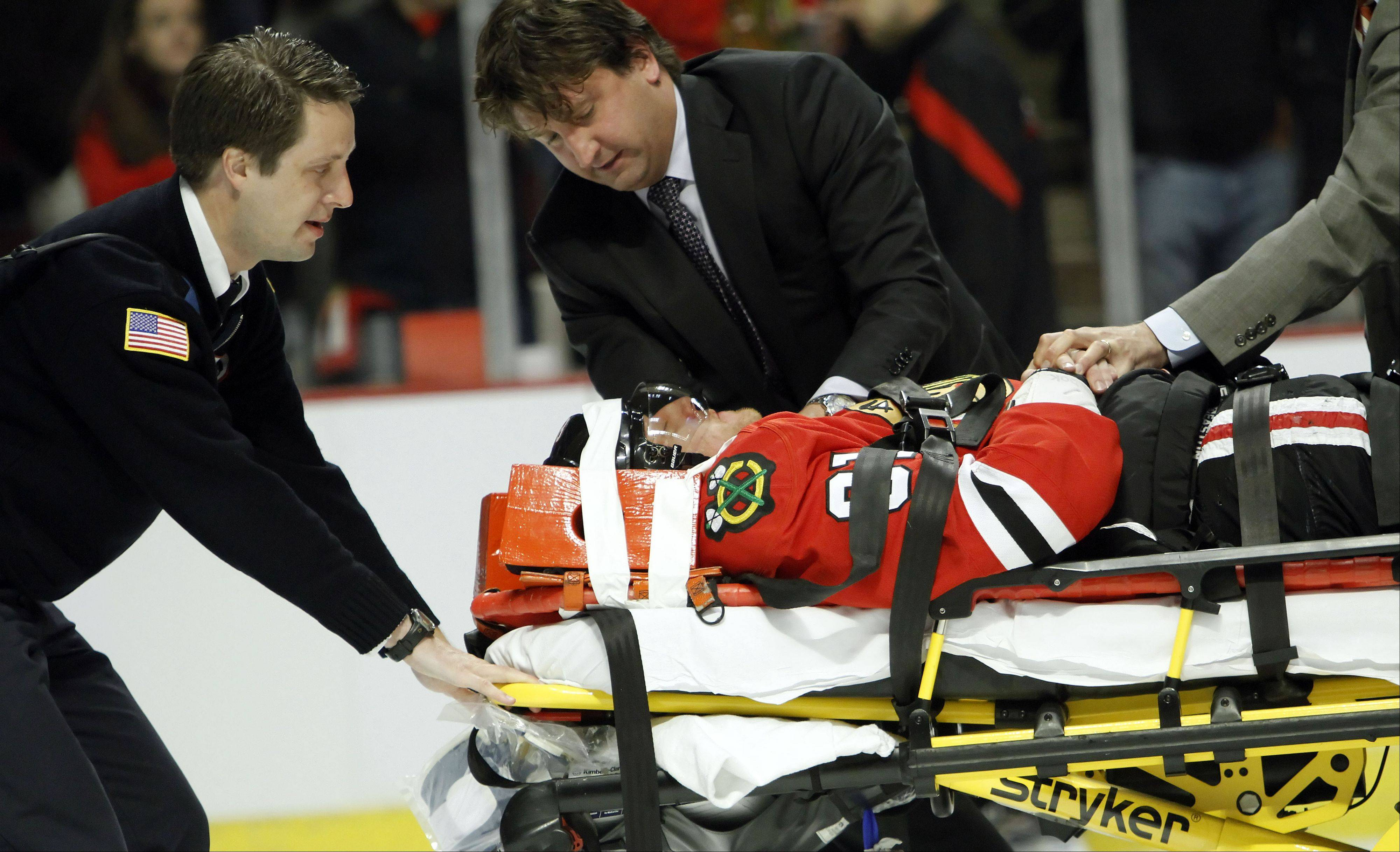 Blackhawks right wing Marian Hossa is taken off the ice on a stretcher after getting an elbow from Phoenix Coyotes left wing Raffi Torres during Game 3 of the Western Conference quarterfinals at The United Center in Chicago Tuesday night.