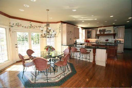 The home's dining room is next to a gourmet kitchen.