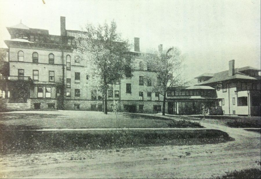Retan Hall, shown on the right, opened as a residence hall for Sherman Hospital nursing students in 1912. The main entrance of the hospital on Center Street is on the left.