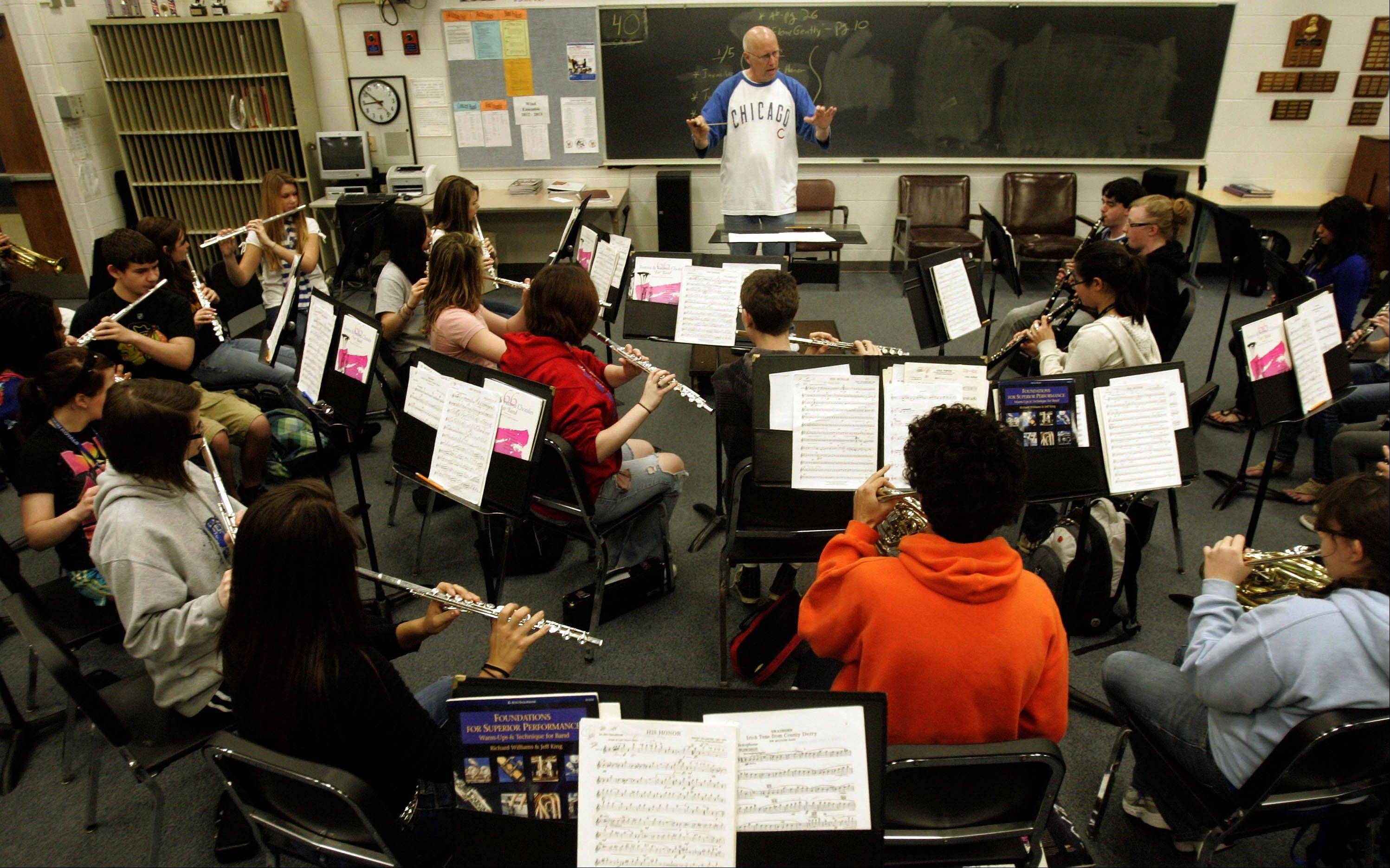 Henning works with the wind ensemble at Larkin High School.