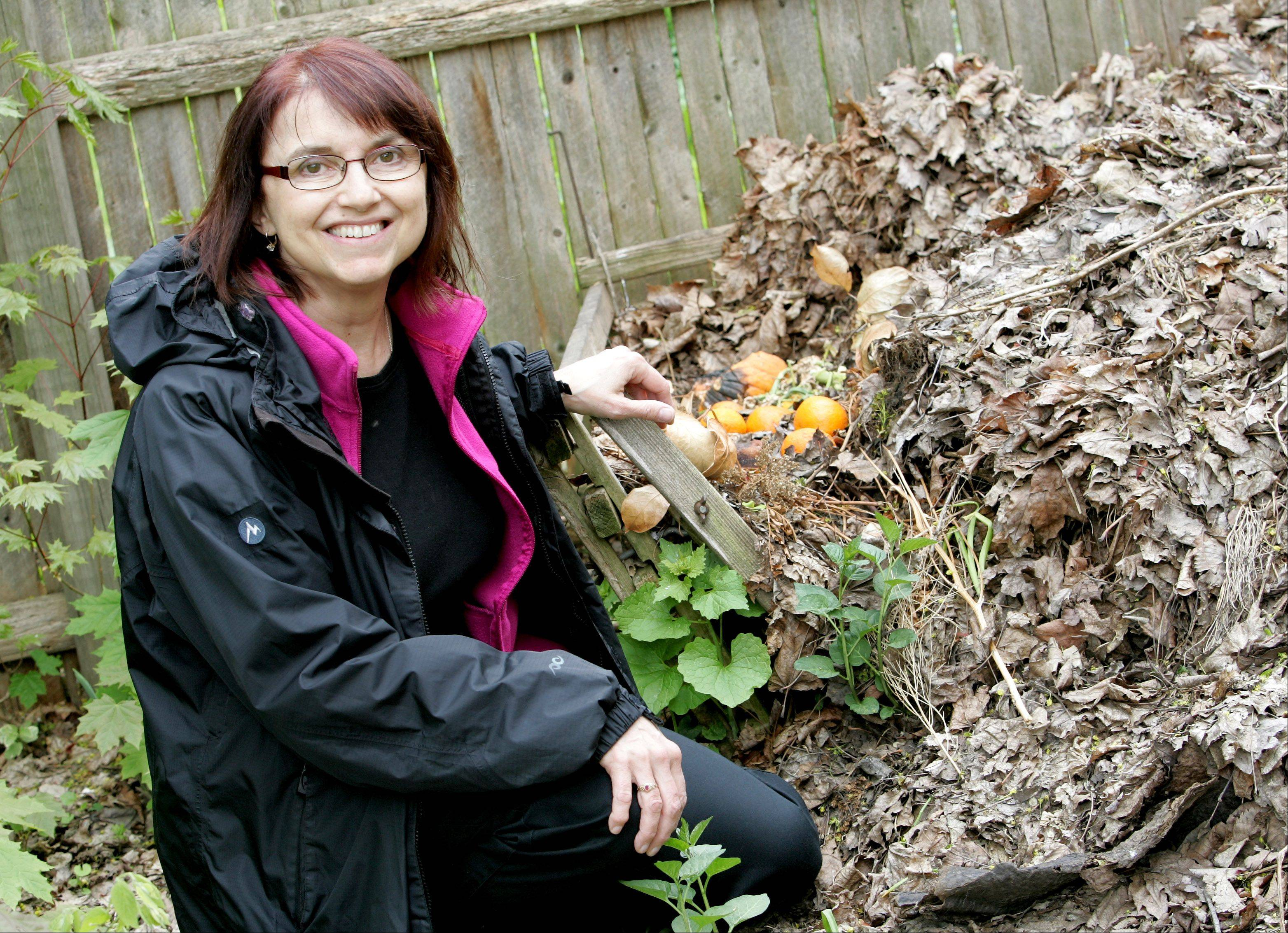 Mavis Bates of Aurora, who started the city's annual Green Fest, has a compost heap in her backyard and promotes conservation by riding her bike when she can instead of driving and cooling her home room by room with small window air conditioners instead of a large central system.