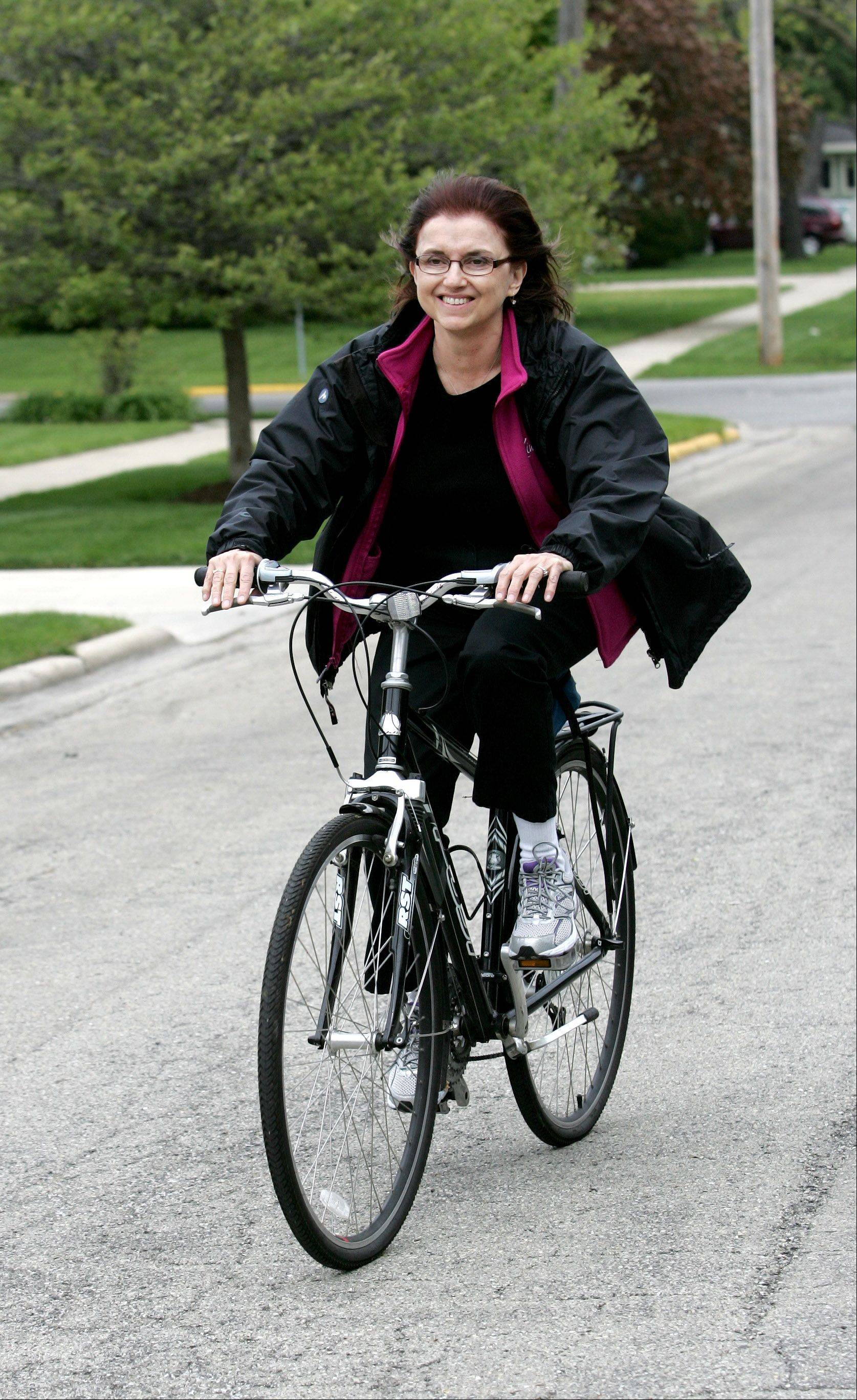 Mavis Bates of Aurora is passionate about conservation, and is working to add to her own environmentally friendly efforts by riding her bike more often instead of driving. She started a group called Aurora Green Lights, which is planning the third annual Aurora Green Fest for June 9.