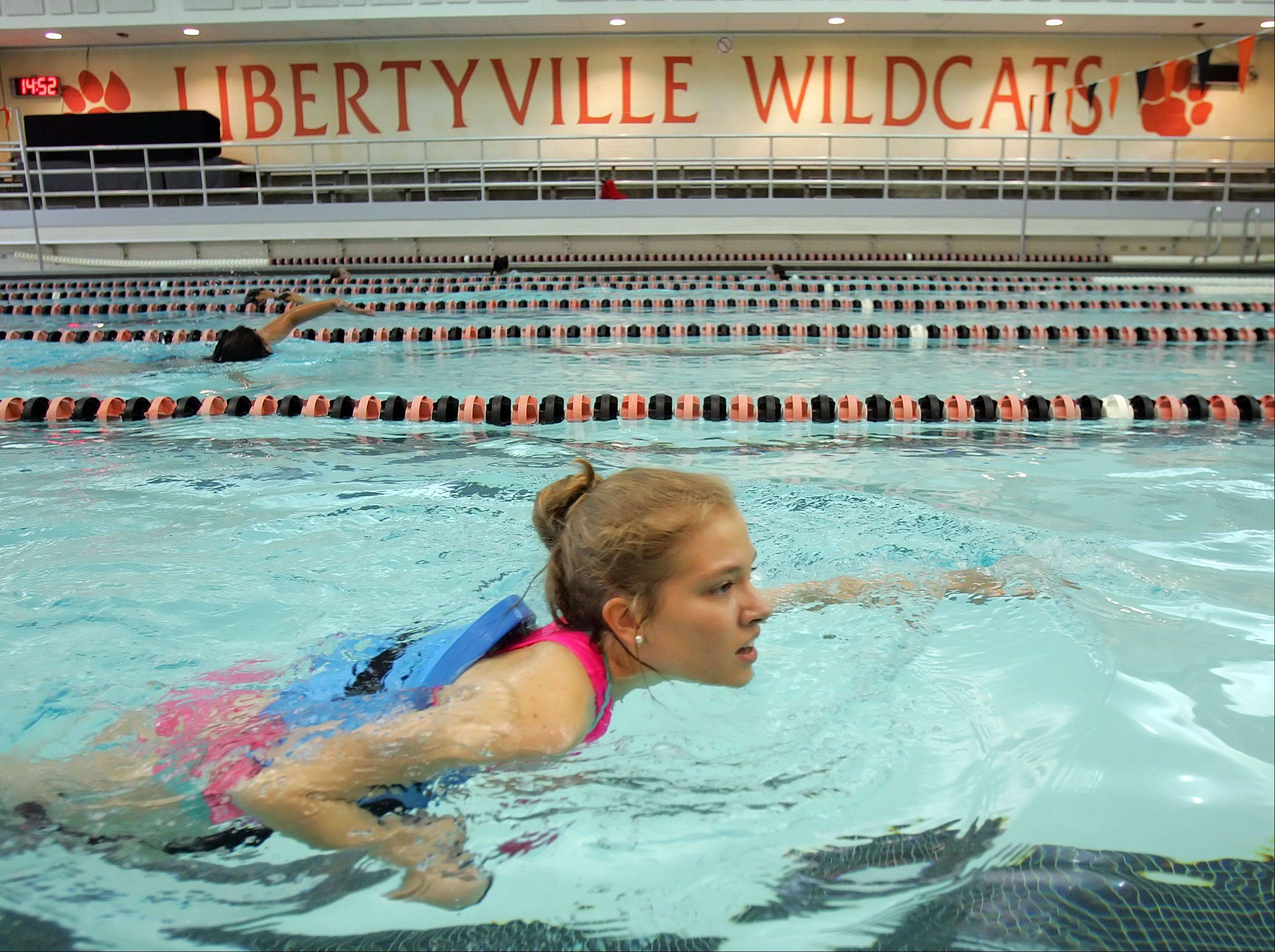 Libertyville High School junior Anna Smiley competes in the swimming portion of a mini-triathlon at Libertyville High School on Thursday morning.