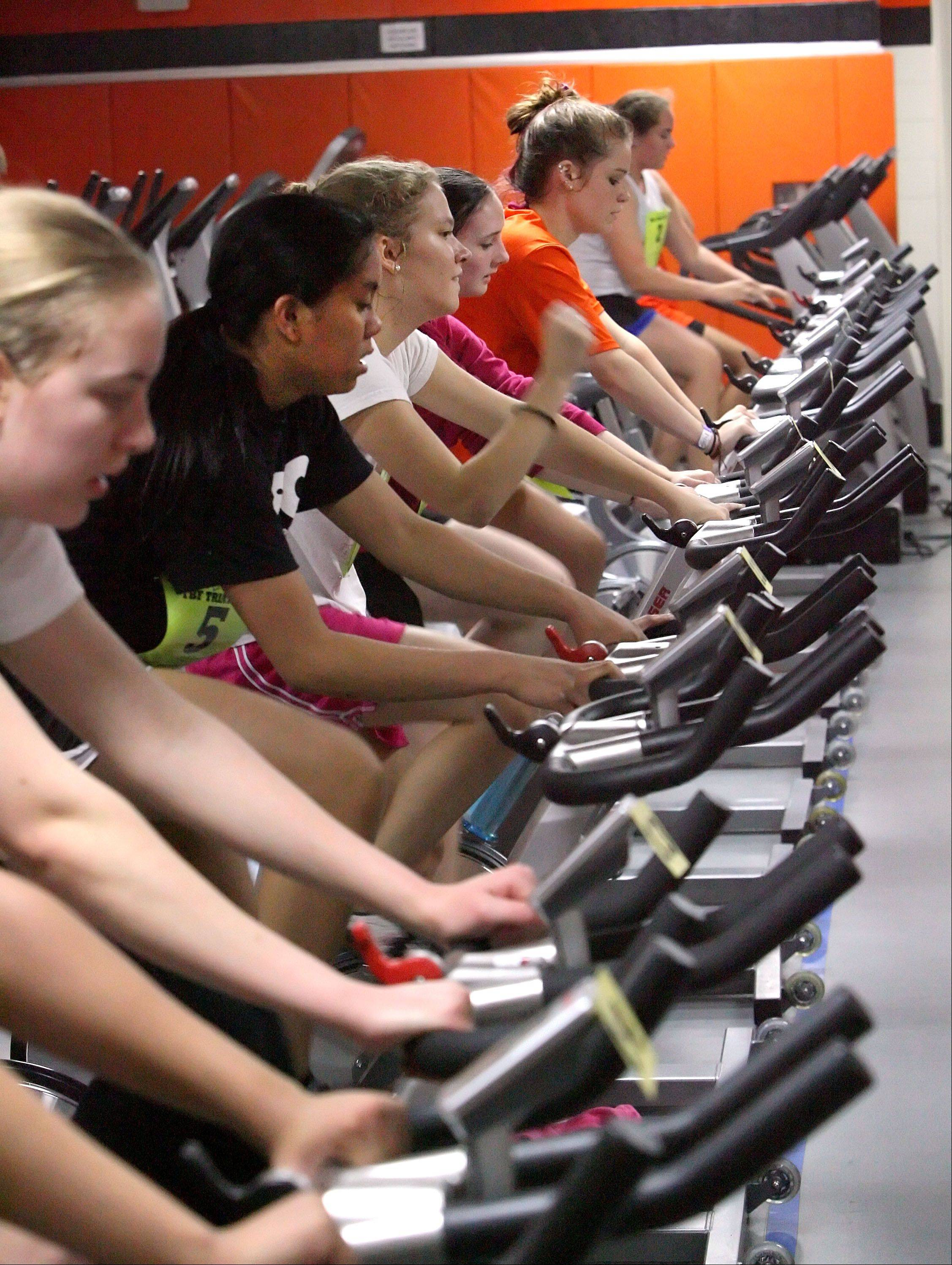Girls compete in the 3-mile biking portion of the Total Body Fitness classes' mini-triathlon.