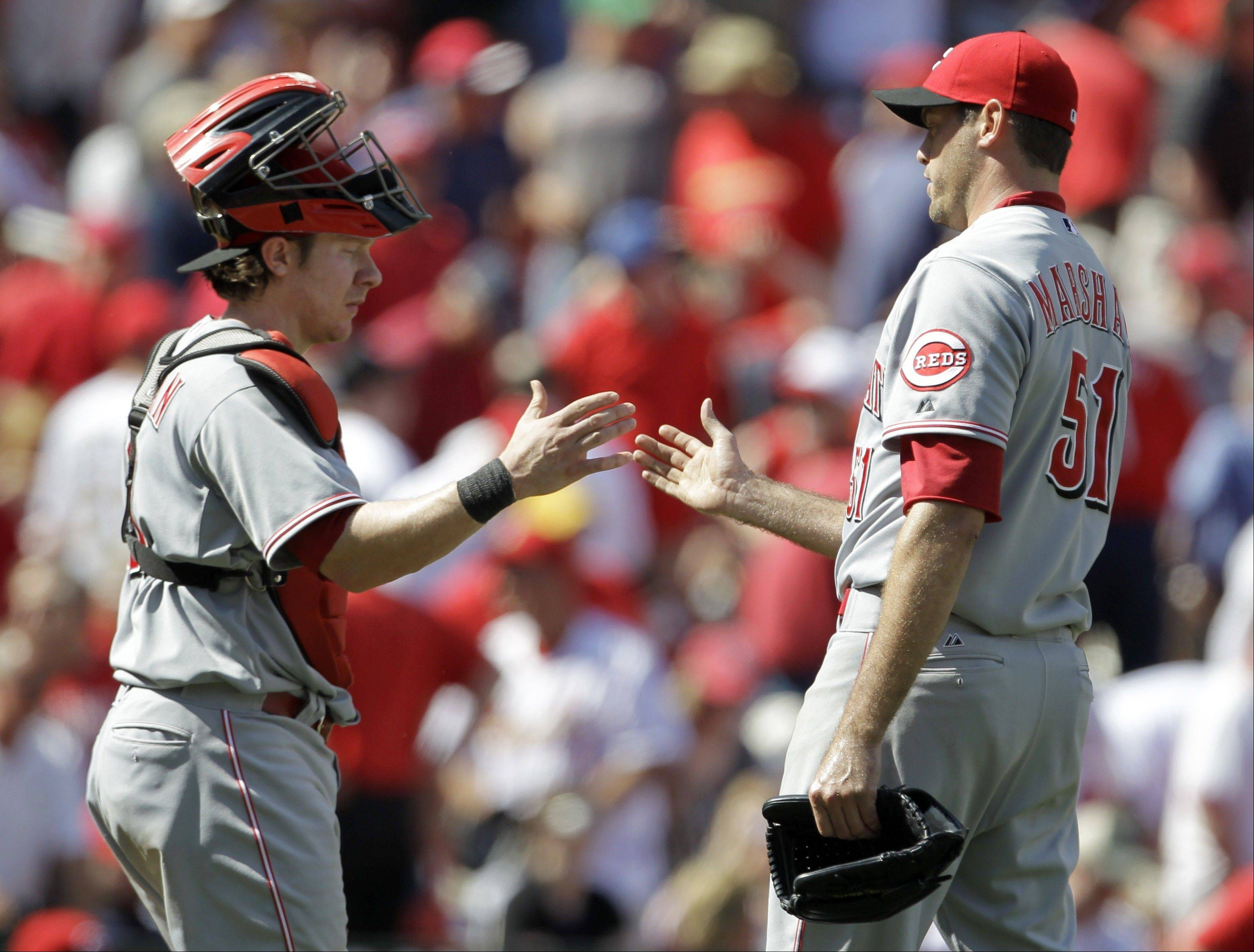 Cincinnati Reds catcher Ryan Hanigan, left, and relief pitcher Sean Marshall celebrate after their 6-3 victory over the St. Louis Cardinals on Thursday, April 19, 2012. Because of injuries, Marshall is Cincinnati's closer for now.