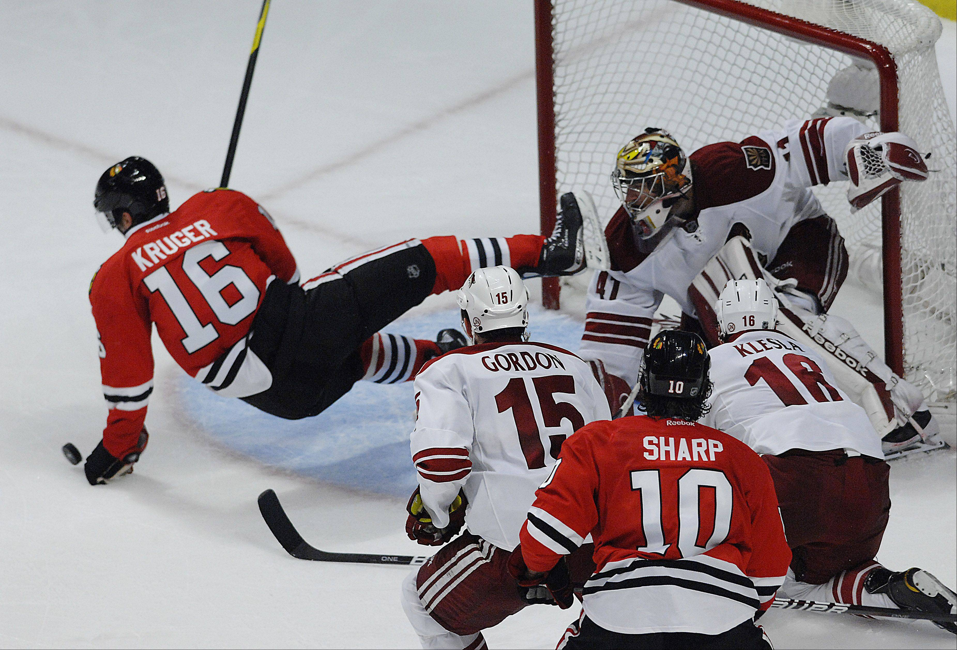 Chicago Blackhawks' center Marcus Kruger falls in front of the net.