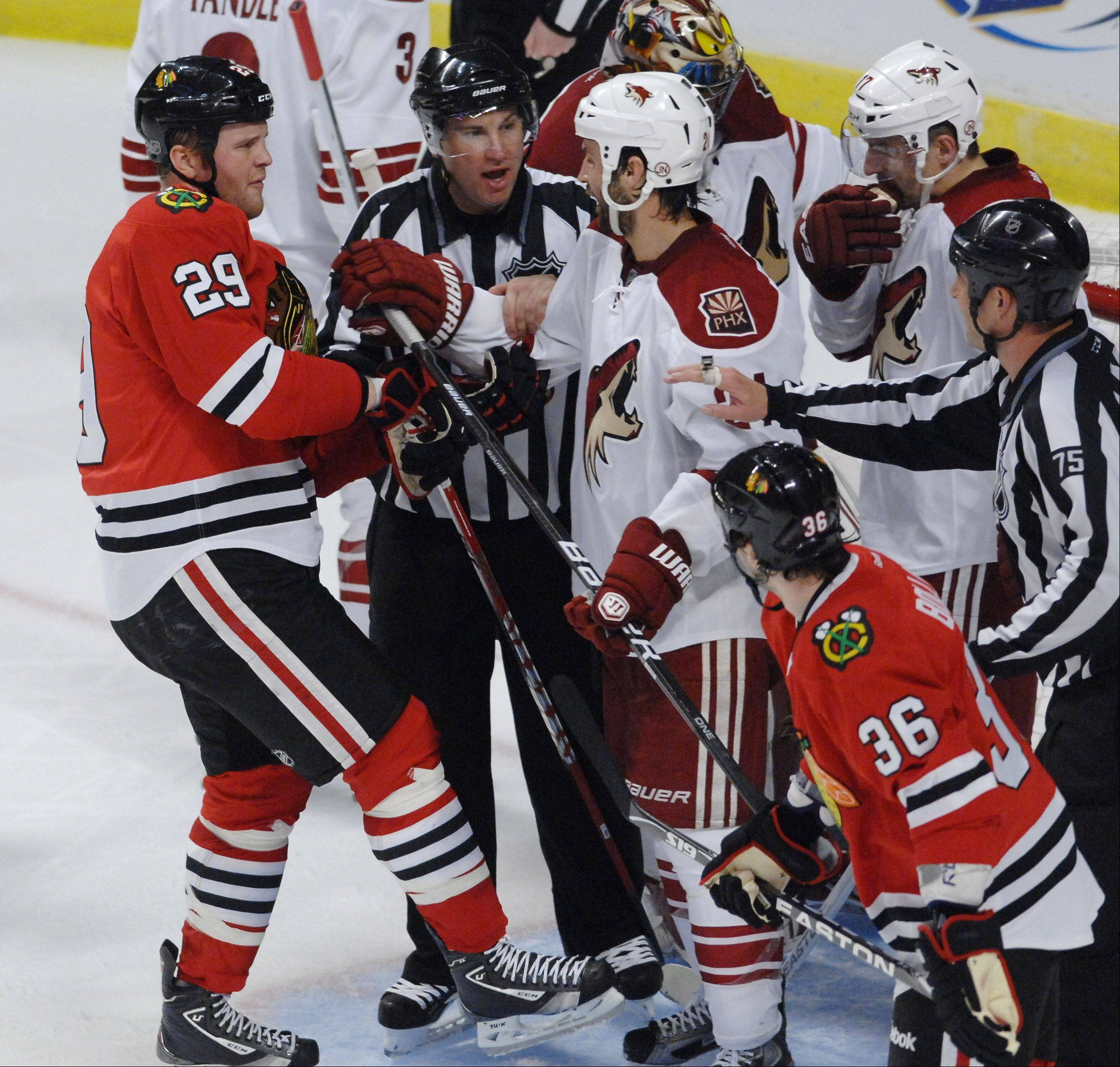 Chicago Blackhawks' left wing Viktor Stalberg faces a group of Phoenix Coyotes.
