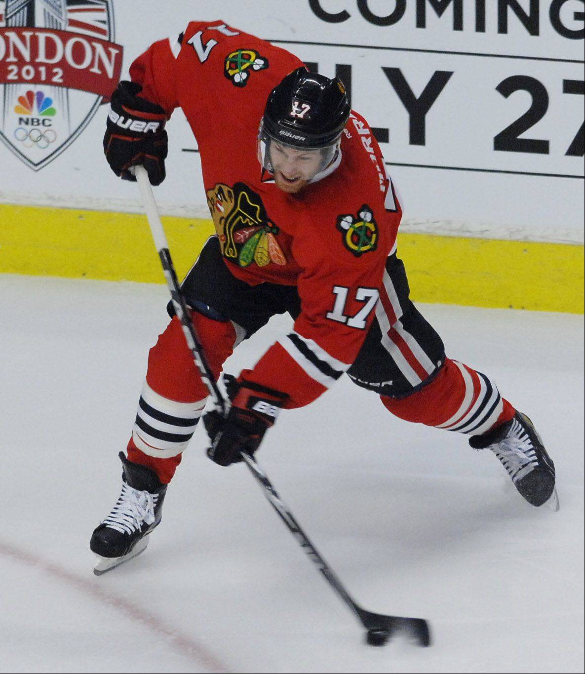 Chicago Blackhawks' center Brendan Morrison fires a goal against the Phoenix Coyotes.