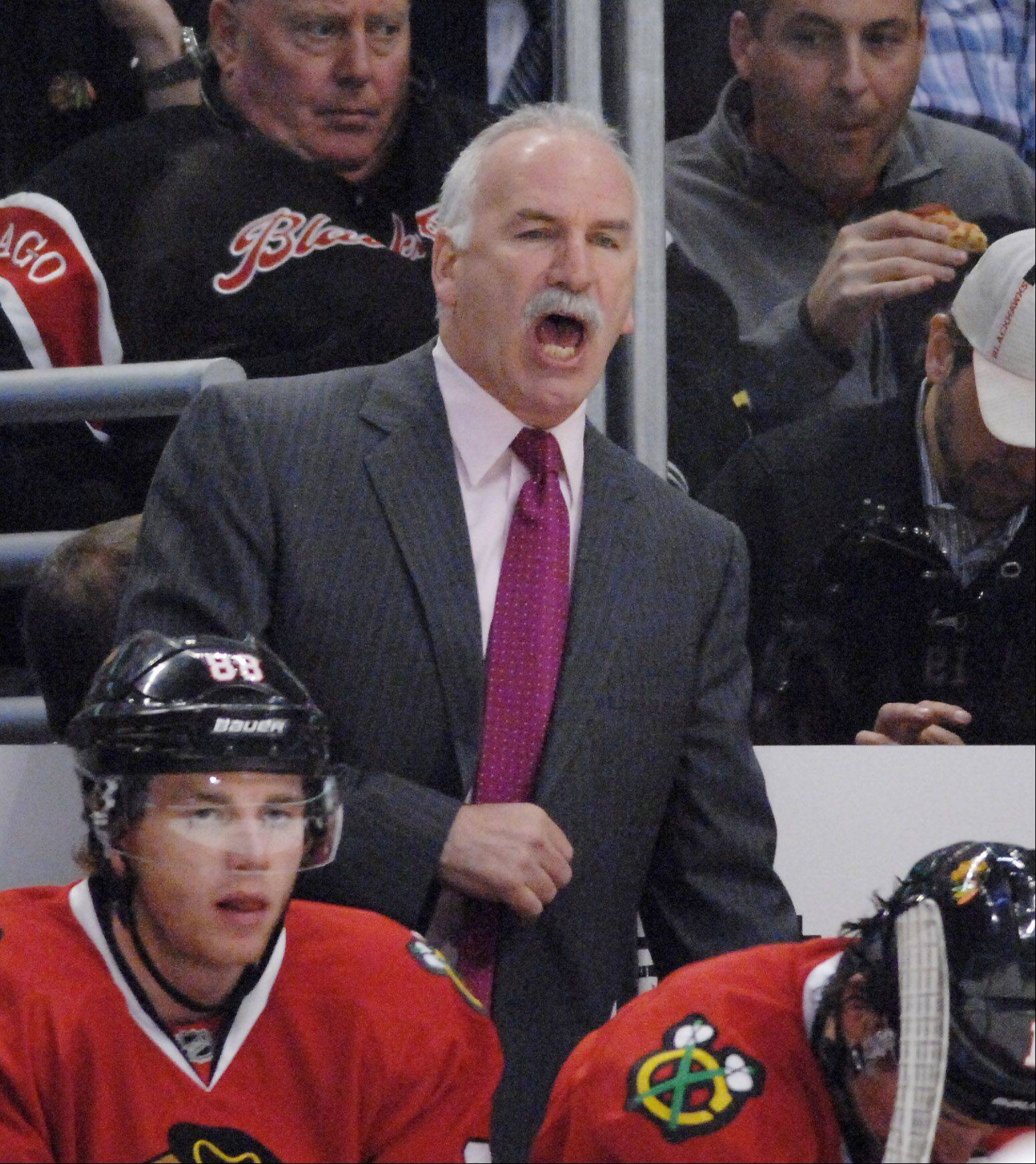 Chicago Blackhawks Coach Joel Quenneville yells instructions.