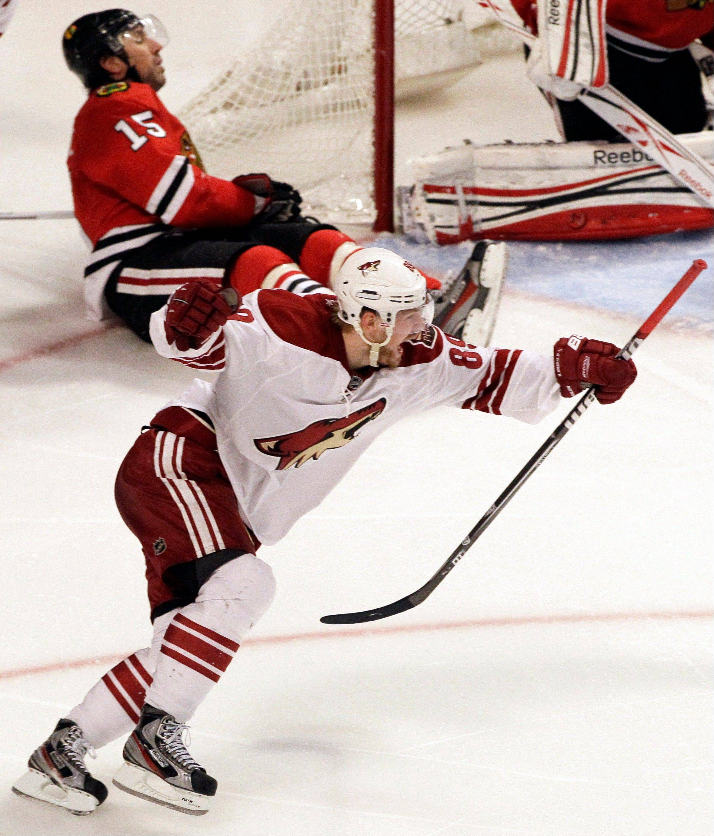 Phoenix Coyotes' Mikkel Boedker (89) celebrates his game-winning goal as Chicago Blackhawks' Andrew Brunette (15) reacts during the overtime period of Game 4 of an NHL hockey Stanley Cup first-round playoff series in Chicago, Thursday, April 19, 2012. The Coyotes won 3-2.