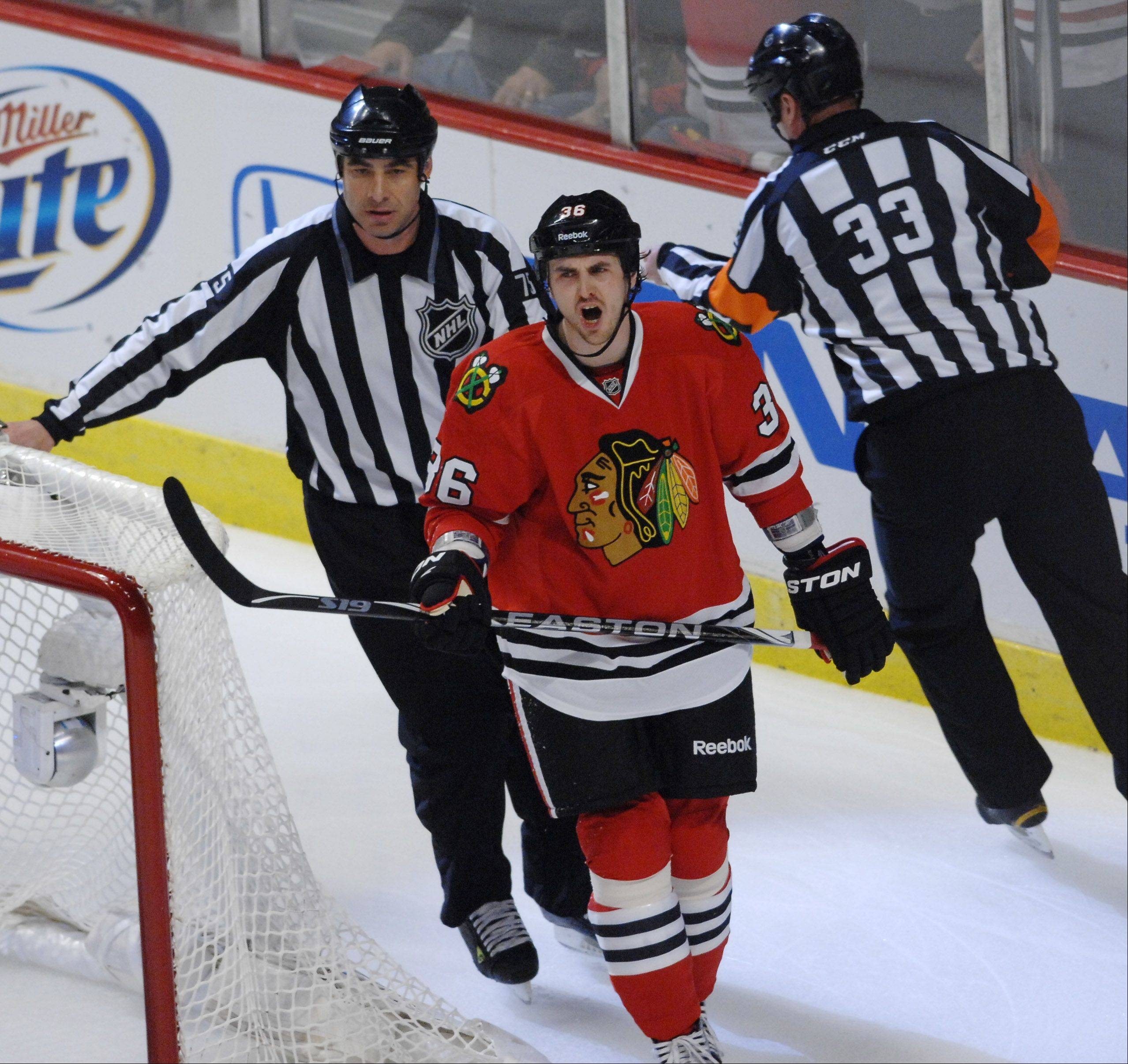 Chicago Blackhawks' center Dave Bolland reacts to an official's call of no goal.