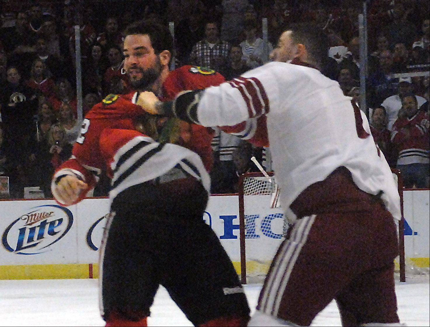 Chicago Blackhawks' left wing Brandon Bollig and Phoenix Coyotes left wing Paul Bissonnette mix it up.