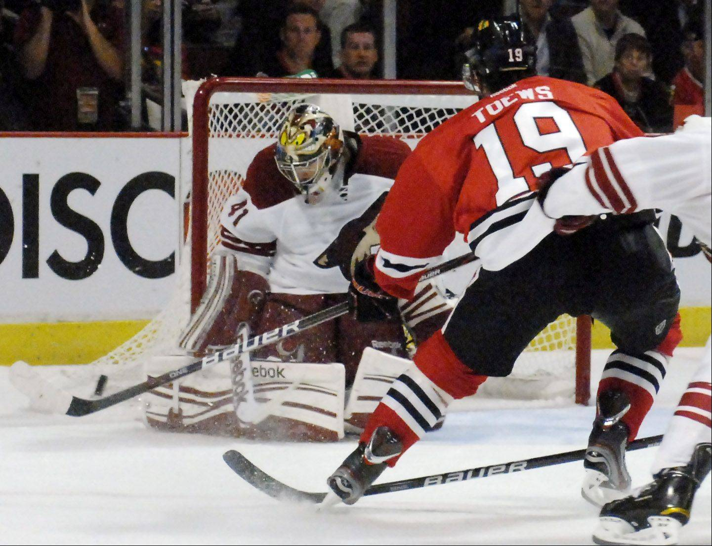 Chicago Blackhawks' center Jonathan Toews' shot is deflected by Phoenix Coyotes goalie Mike Smith in the first period.