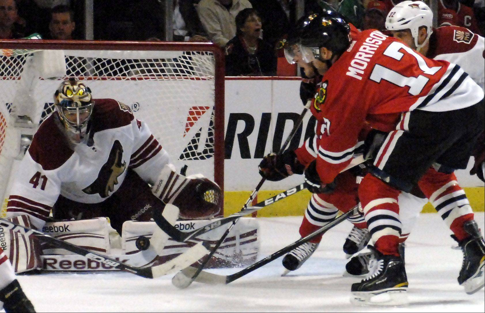 Phoenix Coyotes goalie Mike Smith blocks a shot by Chicago Blackhawks center Brendan Morrison.