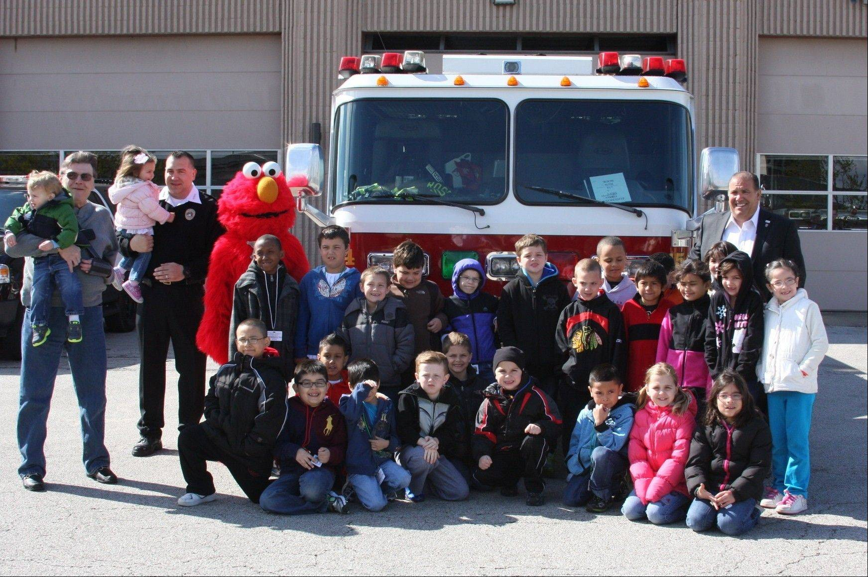 The first-grade class from Rosemont School with Elmo, Mayor Stephens, Superintendent of Public Safety Donald Stephens II and Chief of Public Safety Donald Stephens III.