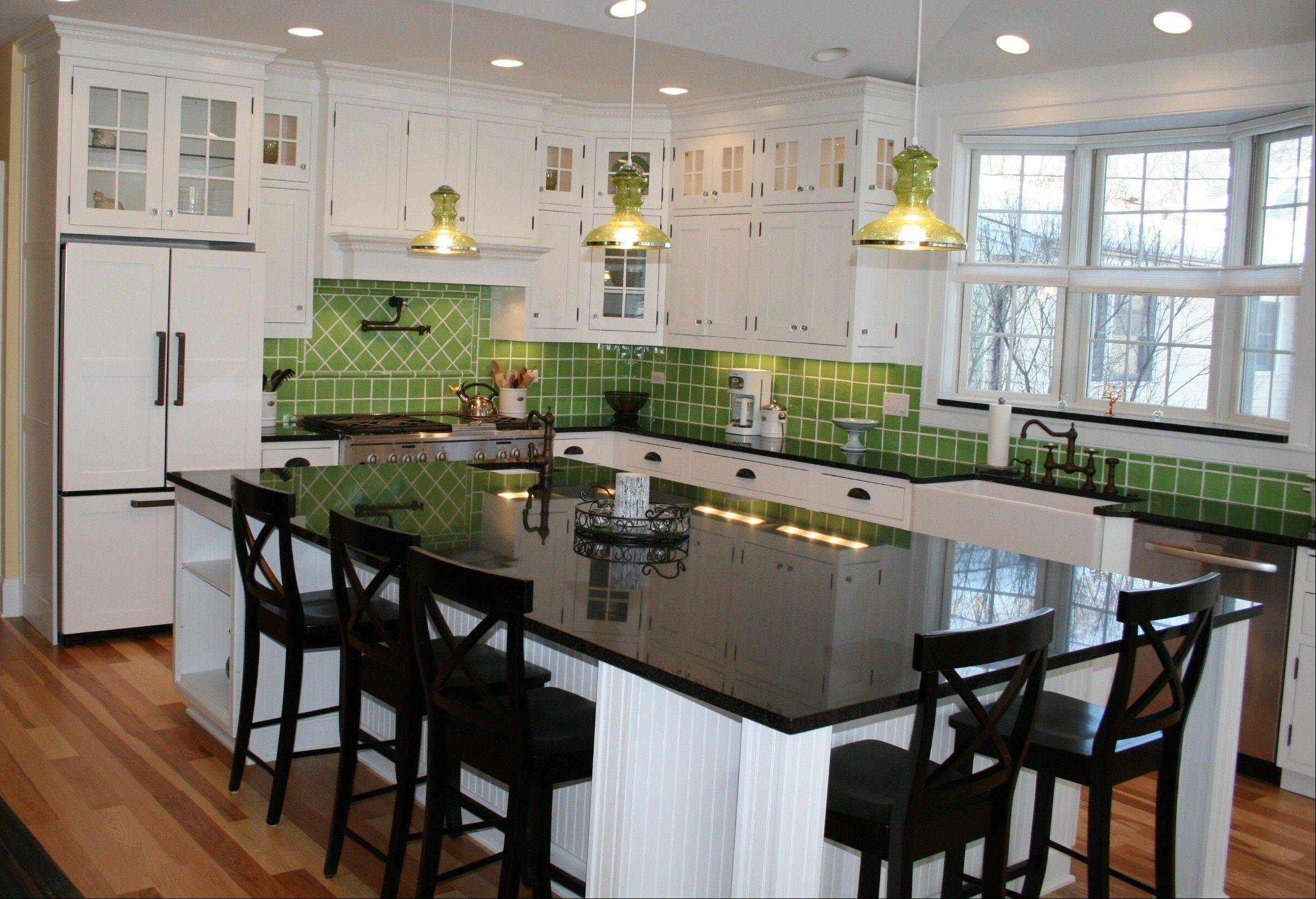 Solid granite backsplashes are no longer as popular in the kitchen, giving way to stone and colorful tile.