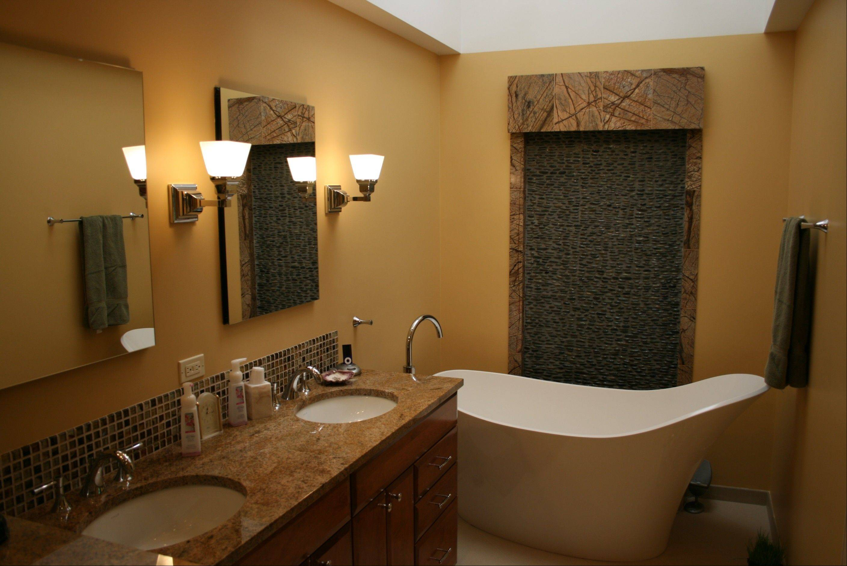 Soaking tubs in the modern home have replaced oversized whirlpools.