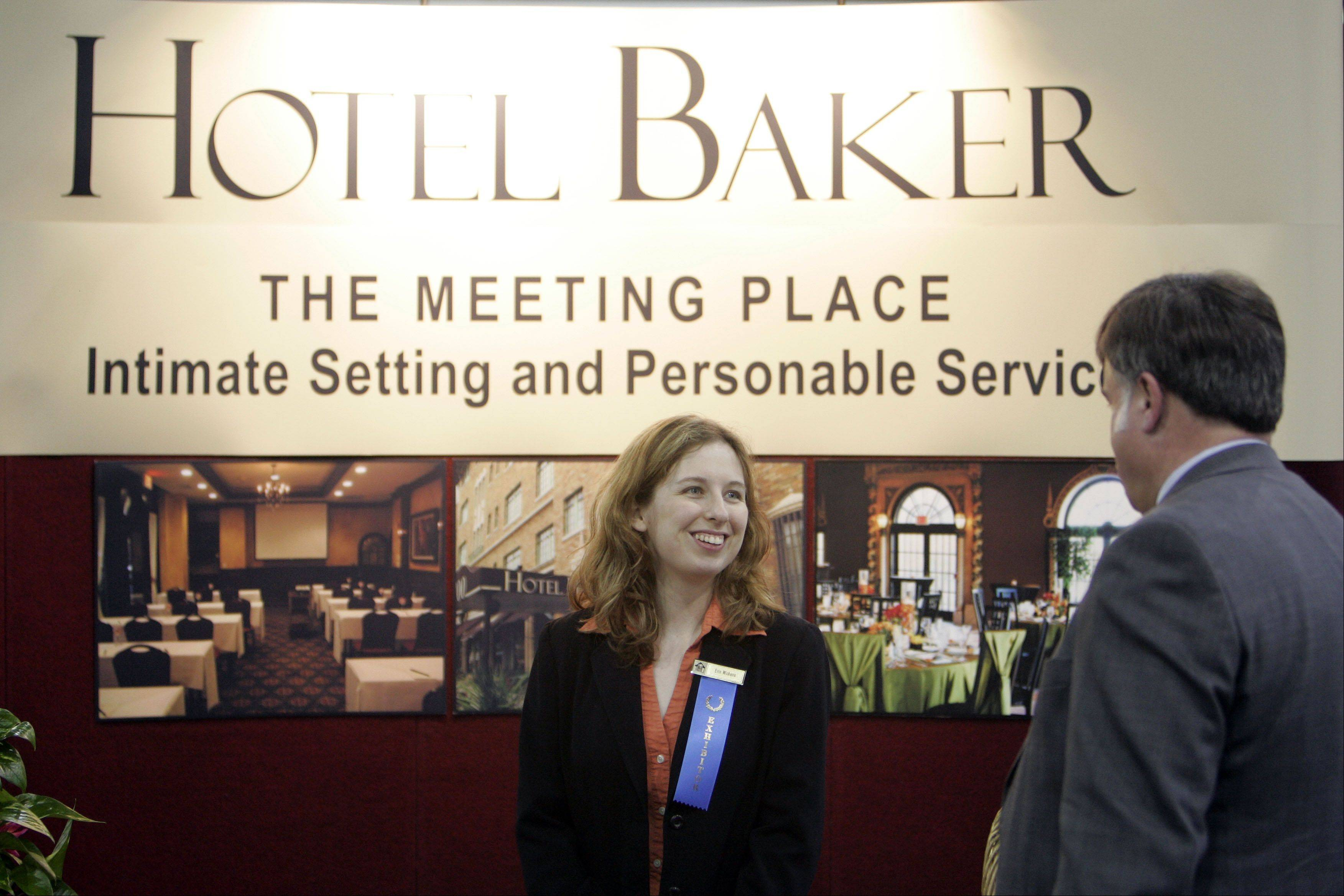 Hotel Baker sales manager Erin Wickens talks with a prospective customer during last year's Rolling Down the River expo at Pheasant Run in St. Charles. This year's event is from noon to 6 p.m. Wednesday, April 25, at the MegaCenter.