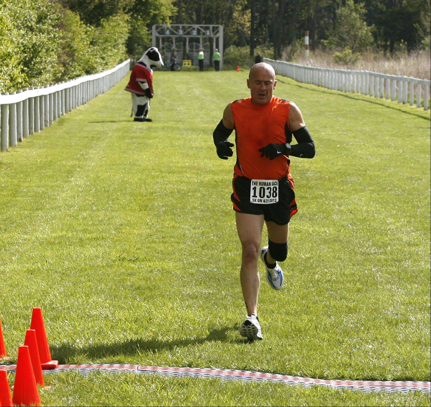 Barry Brandt, 54, of Villa Park wins the inaugural Human Race, a 5K run and 2-mile walk held Saturday in Danada Forest Preserve. A total of 1,000 runners and walkers participated.