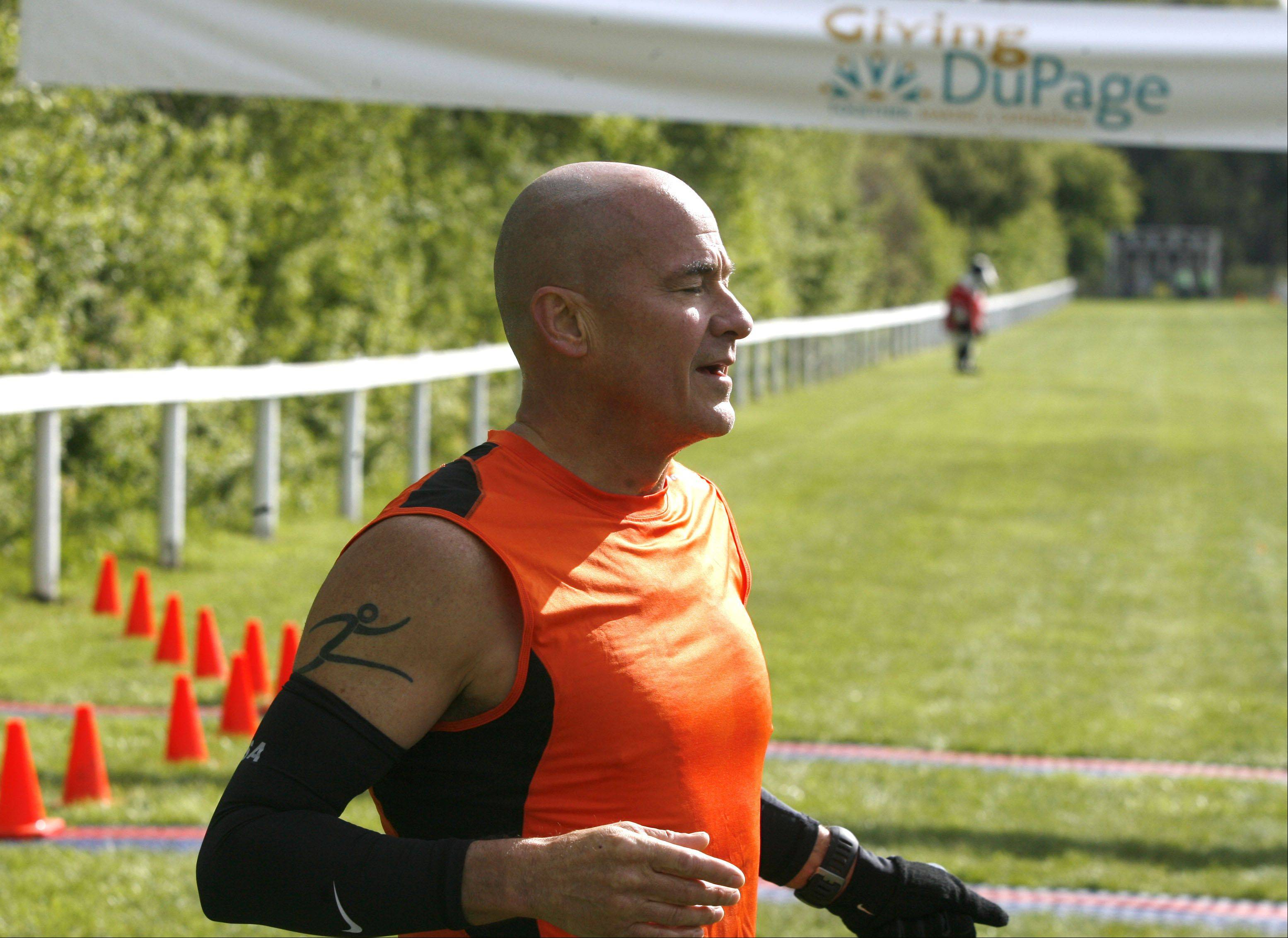 Barry Brandt, 54, of Villa Park wins the inaugural Human Race, a 5K run and 2-mile walk held in Danada Forest Preserve in Wheaton. Race participants raised money for the local charity of their choice. Brandt's winning time was 17:49.