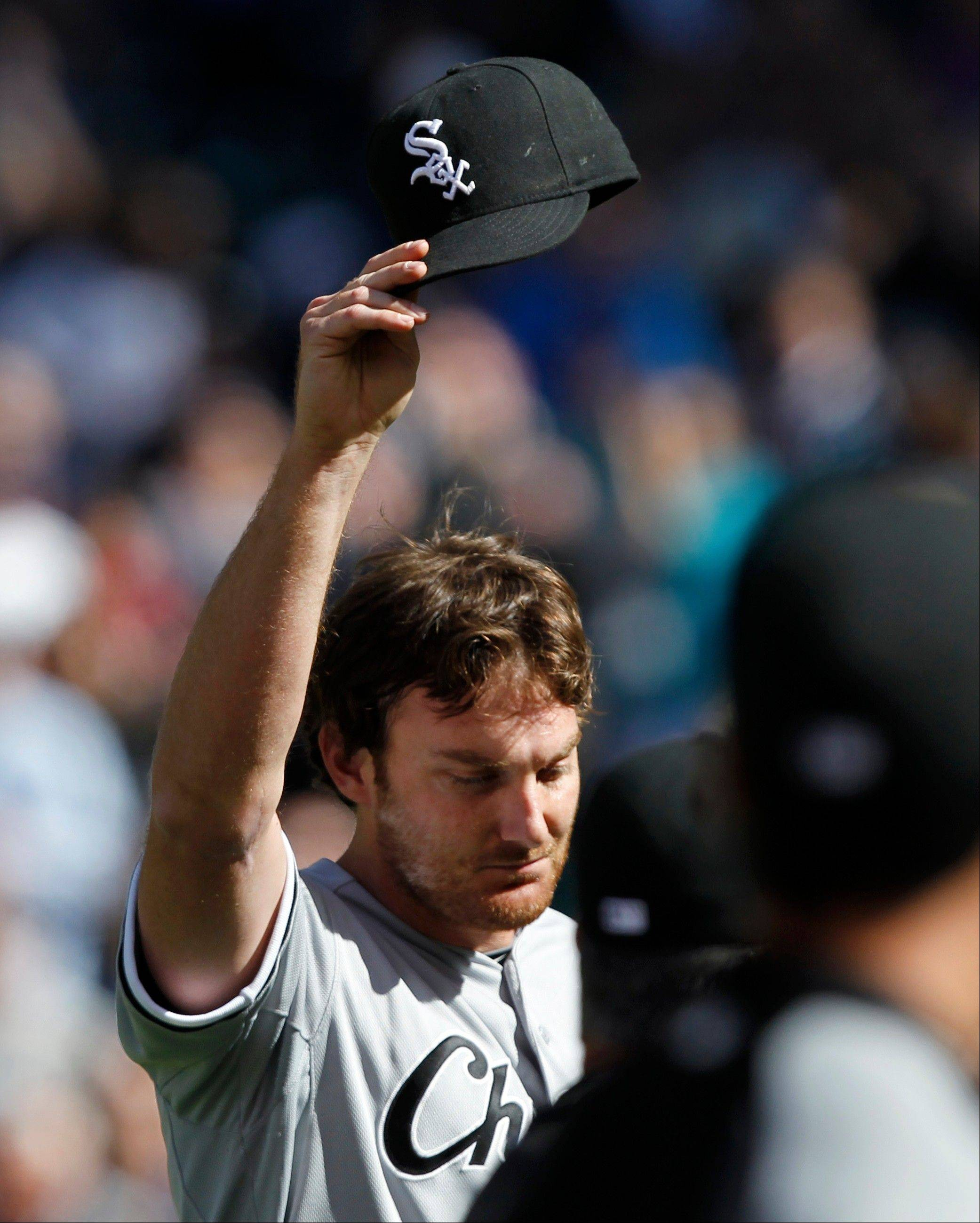 Chicago White Sox starting pitcher Phil Humber waves his cap after pitching a perfect baseball game against the Seattle Mariners, Saturday, April 21, 2012, in Seattle. The White Sox won 4-0.