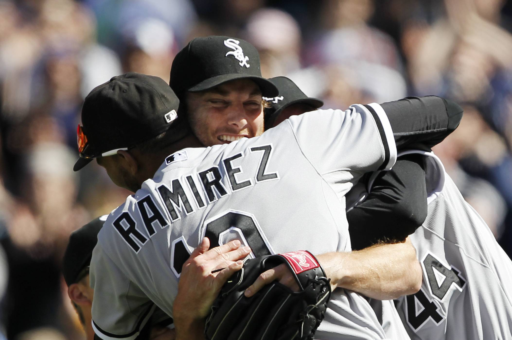 White Sox starting pitcher Philip Humber, center, is mobbed by teammates after pitching a perfect baseball game Saturday against the Seattle Mariners in Seattle. The White Sox won 4-0.