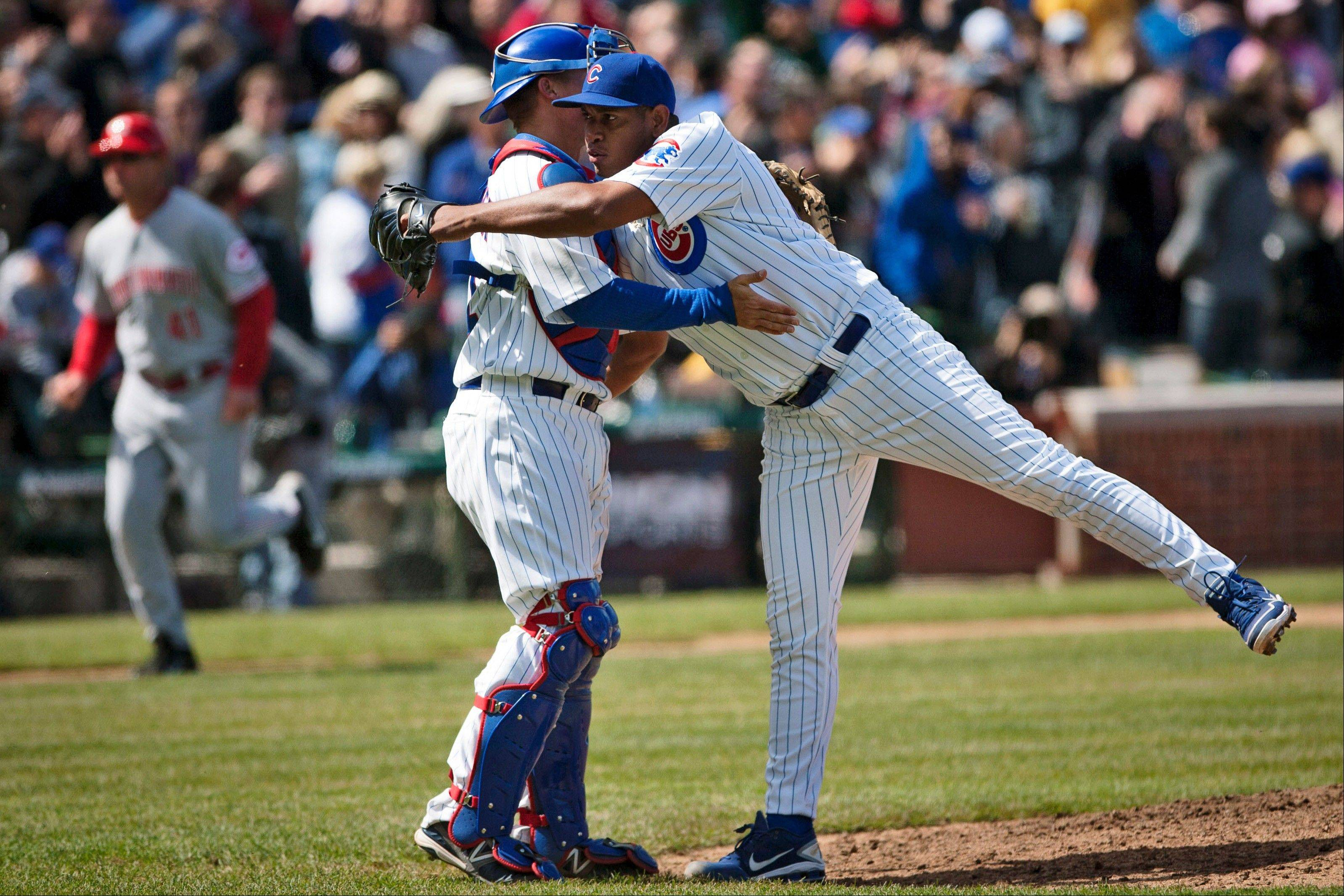 Cubs closer Carlos Marmol hugs catcher Steve Clevenger after defeating the Cincinnati Reds 6-1 Saturday at Wrigley.