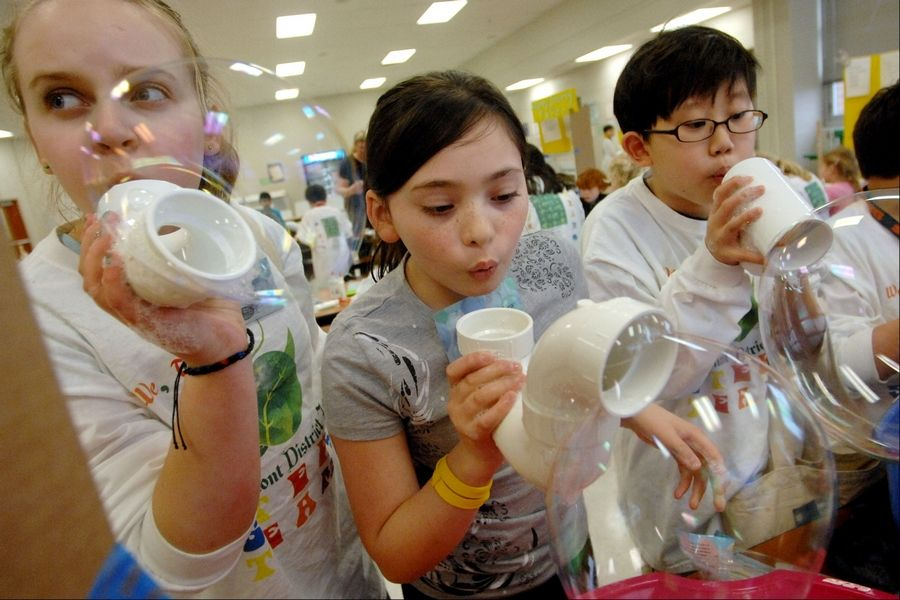 Fremont Intermediate students Ella Krauss, left, Sydney Bradshaw and Wonjun Park blow bubbles during the science, technology, engineering, art and math (STEAM) after-school program.