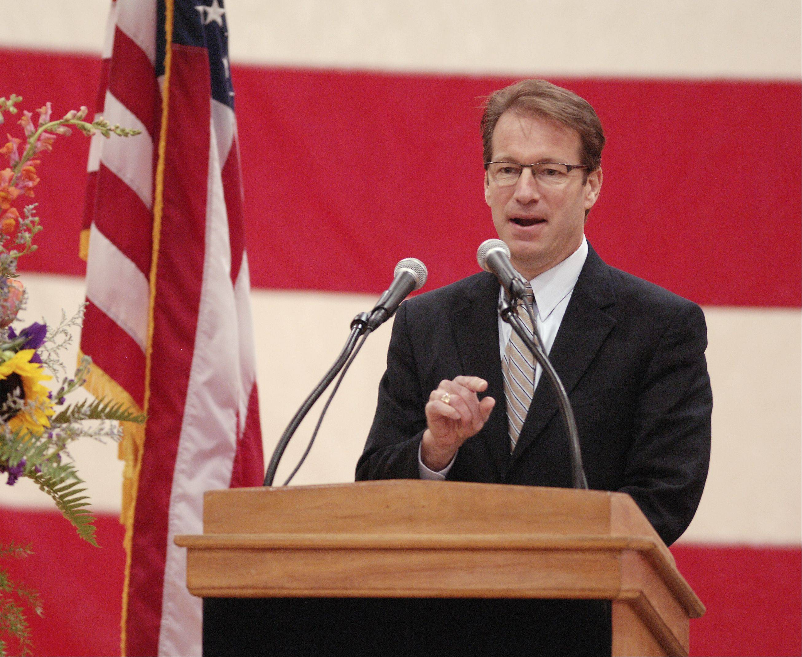 Congressman Peter Roskam speaks Sunday at the memorial service for West Chicago Mayor Mike Kwasman at West Chicago High School.