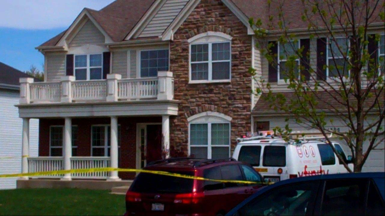 Police tape surrounds a Hoffman Estates home where an 11-year-old boy was found outside unconscious and not breathing Saturday. Allan Fernandez died later that afternoon.