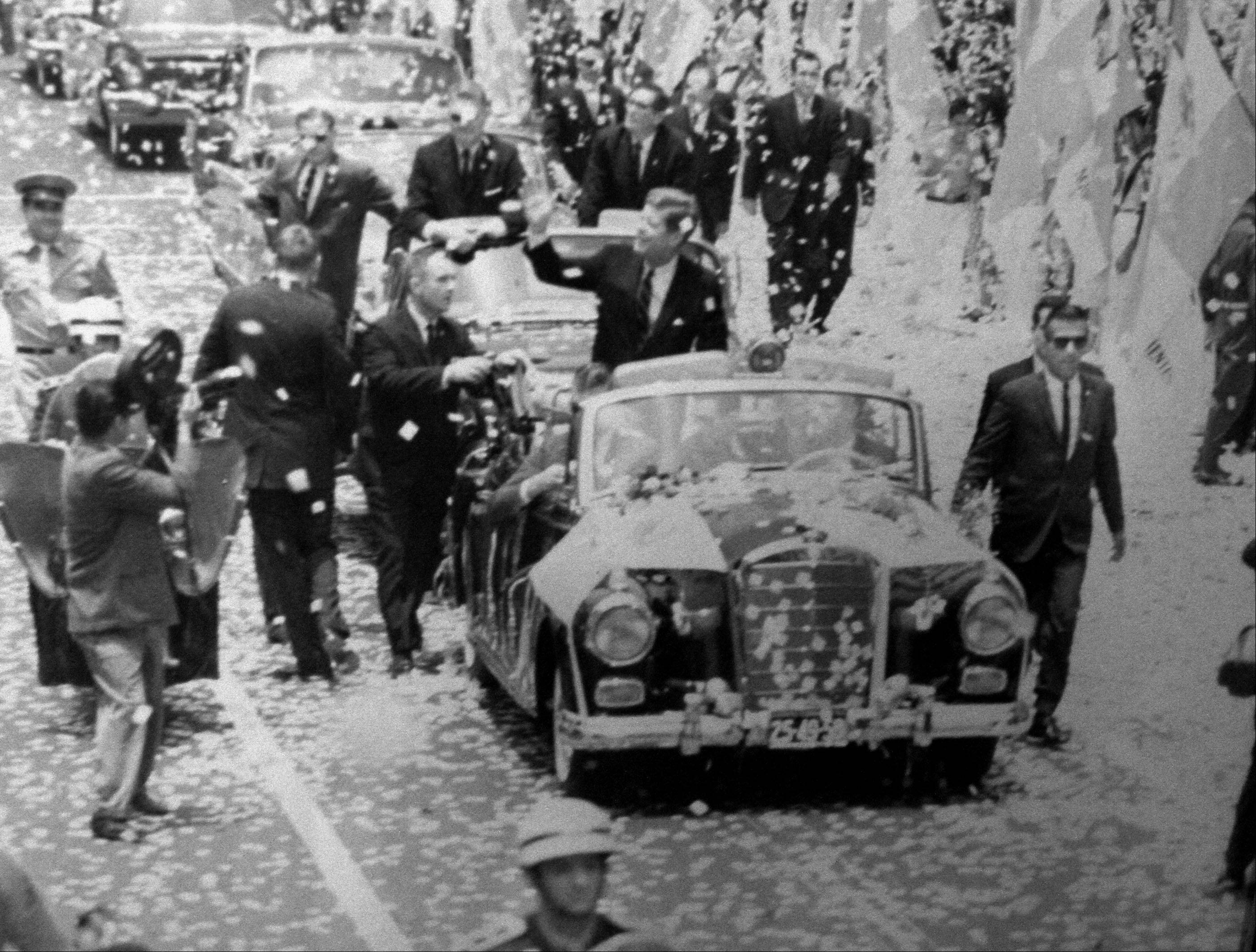 Ken Giannoules of Arlington Heights, right of car wearing sunglasses, working as a Secret Service agent on detail with President John F. Kennedy during a parade in Mexico City in 1962. Giannoules said all of his historical photographs are kept at a storage location.
