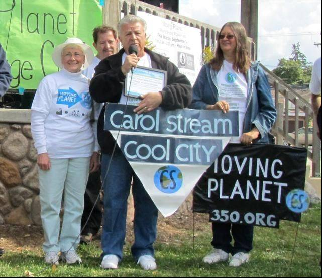 Carol Stream Village President Frank Saverino joined Jan Smith and Suzanne Carlstedt of the Cool Cities Coalition at a Moving Planet Day ceremony on Sept. 24, 2011 in Villa Park.